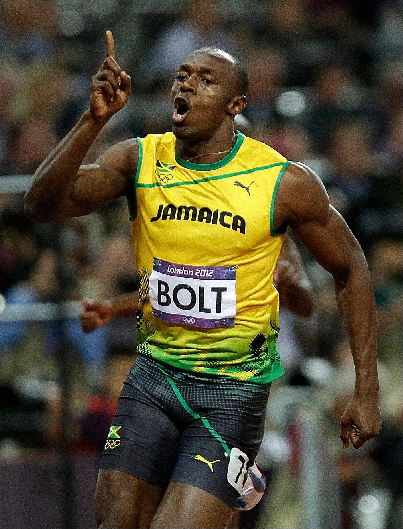 Jamaica's Usain Bolt celebrates Sunday after winning the men's 100-meter final race at Olympic Stadium in London.