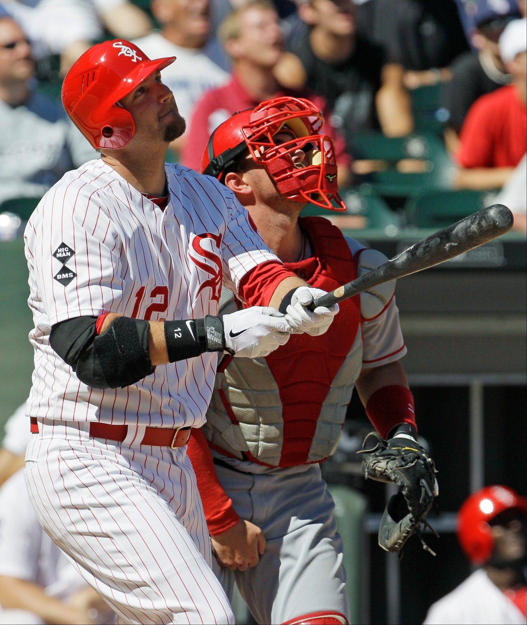 White Sox catcher A.J. Pierzynski watches his two-run home run fly Sunday as Los Angeles Angels catcher Bobby Wilson looks on at U.S. Cellular Field.