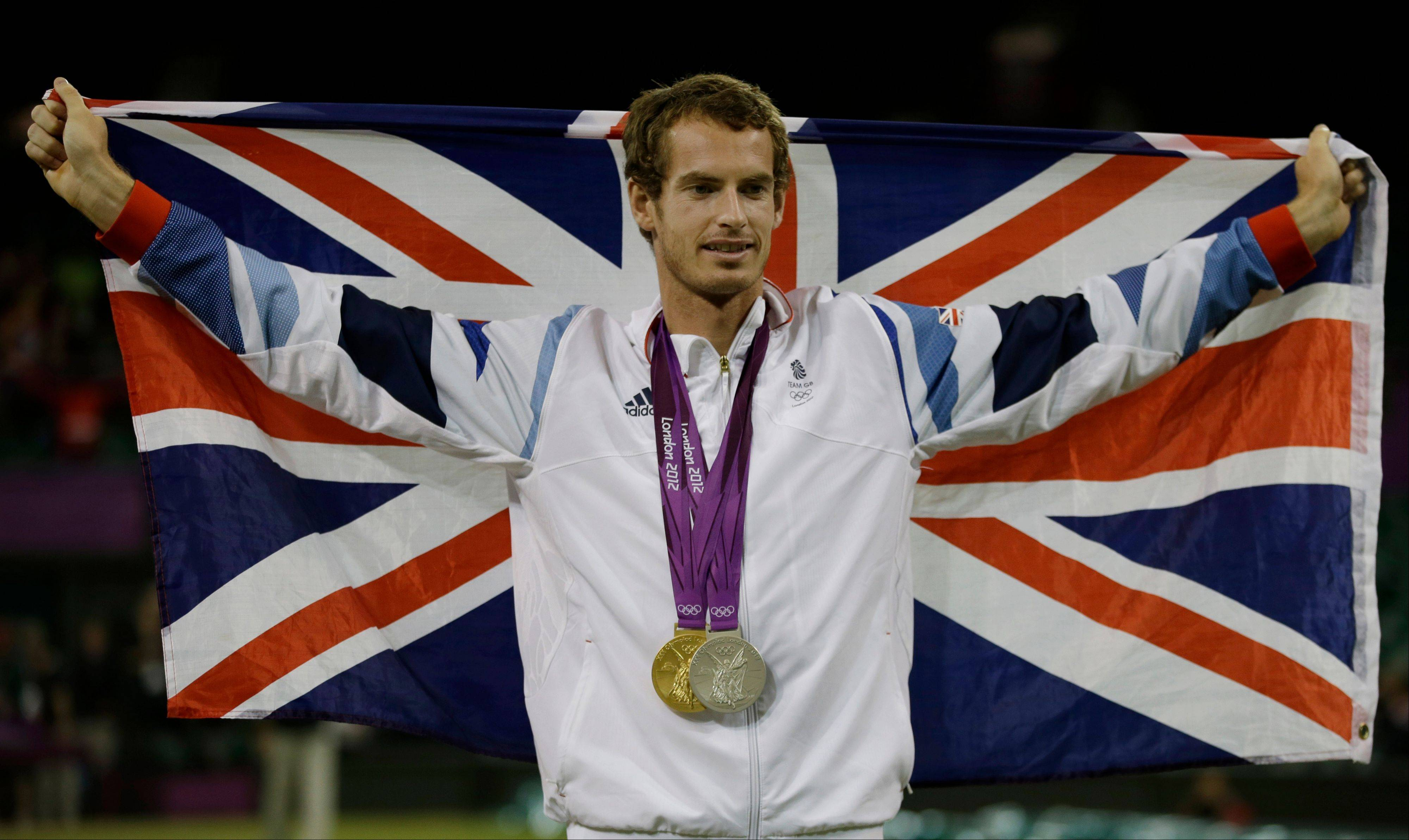 Andy Murray of Great Britain poses with his gold and silver medals Sunday at the All England Lawn Tennis Club in Wimbledon, London at the 2012 Summer Olympics.