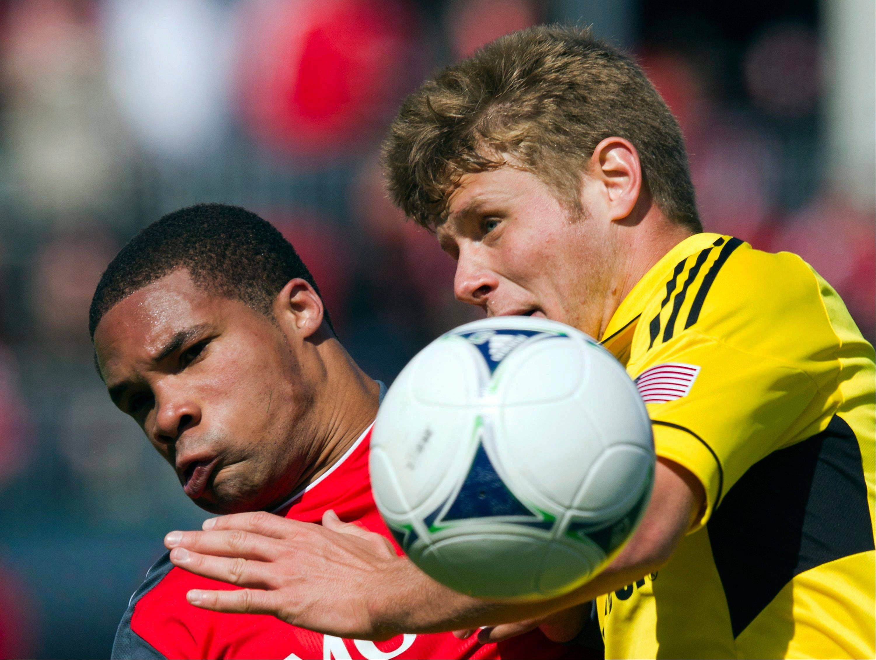 Columbus Crew midfielder Kirk Urso, right, battles for the ball last March with Toronto FC forward Ryan Johnson during a game in Toronto. Urso, 22, was pronounced dead early Sunday after he was found unconscious in a Columbus bar.