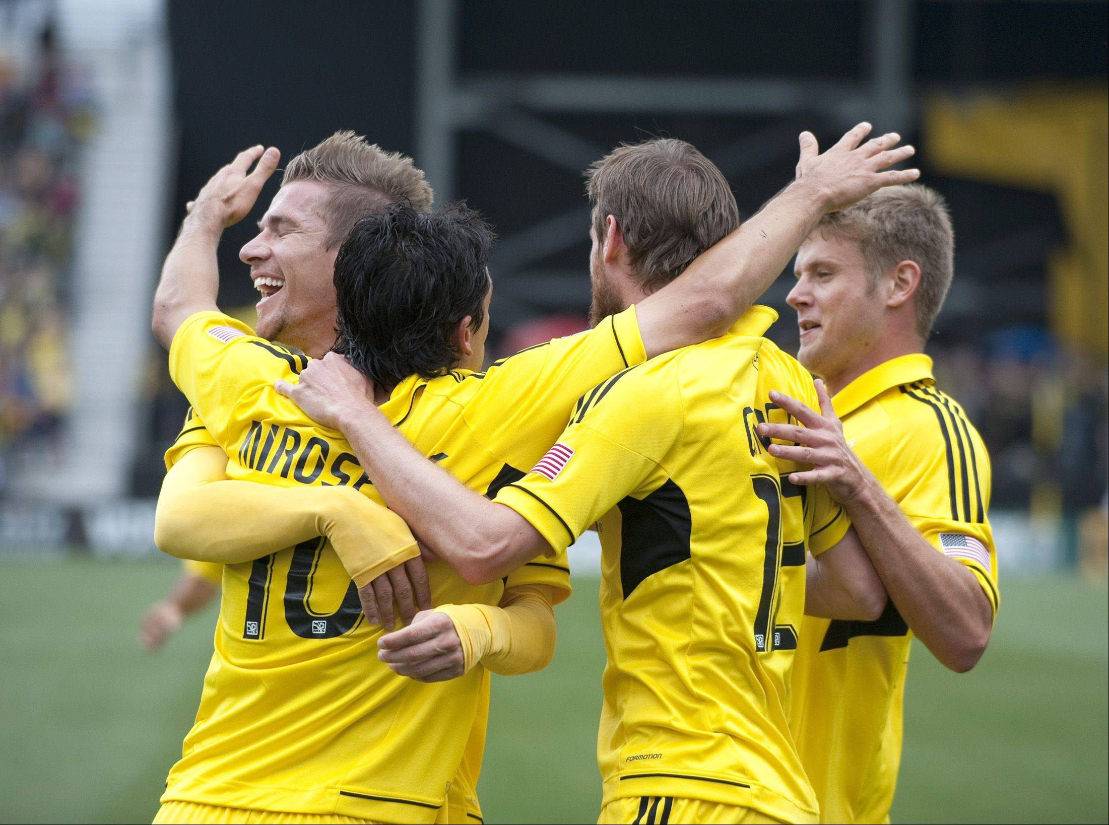 Columbus Crew midfielder Kirk Urso (15) (far right) celebrates with teammates against the Montreal Impact for the opening game of the season at Crew Stadium in Columbus on March 24. Urso was pronounced dead early Sunday at Grant Medical Center in Columbus.