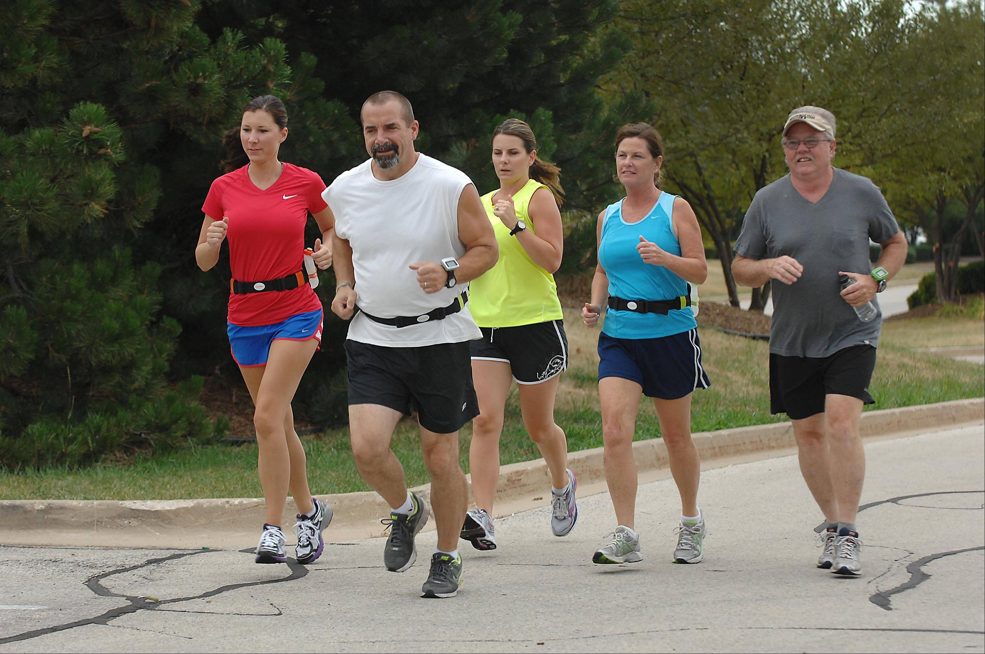 The Shlub Club, a group of runners that meets at Dick Pond Athletics in Carpentersville, runs together near the store weekly. From left are Nicole Kotelman, Paul Turnbaugh, Carolyn Chesta, Donna Hayes, and Joe Maney.