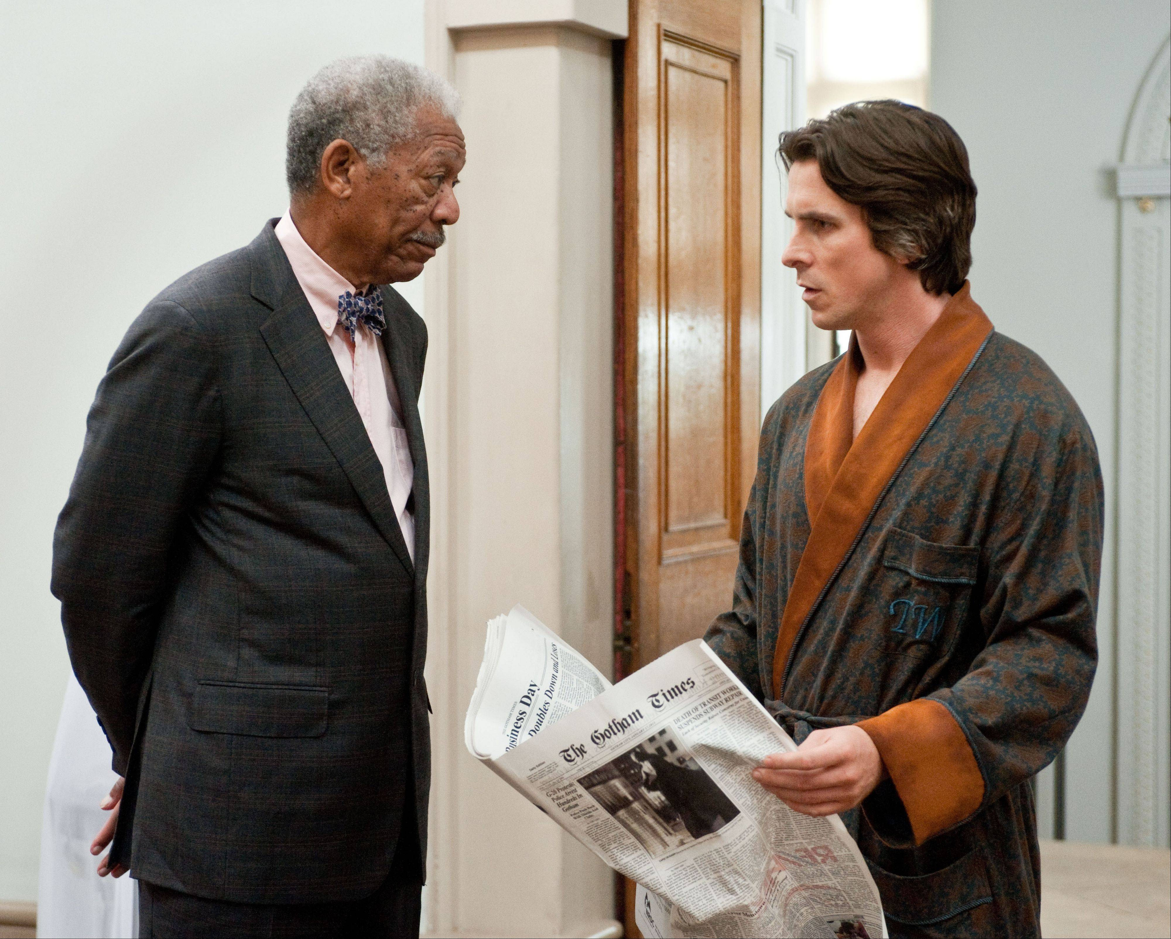 "Morgan Freeman, left, reprises his role as Lucius Fox and Christian Bale as Bruce Wayne in ""The Dark Knight Rises."""