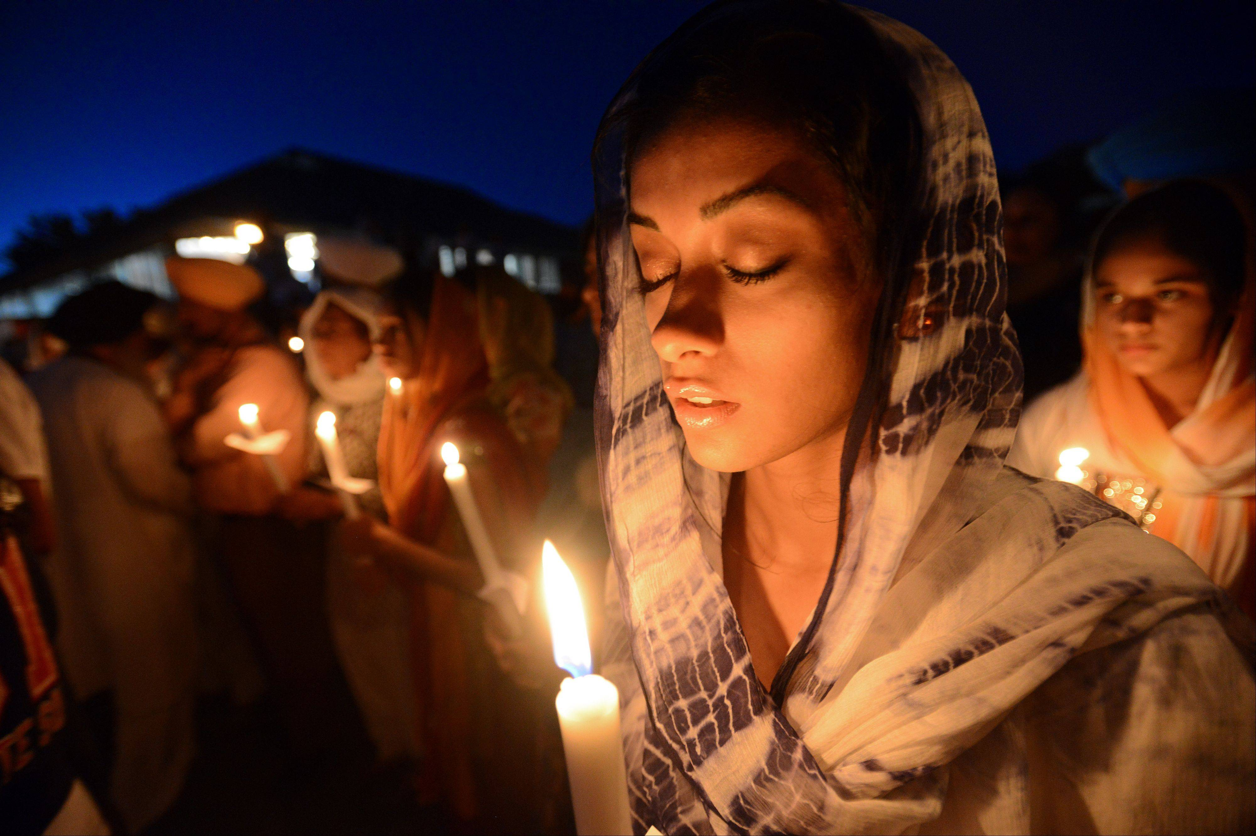 Ruby Singh,22, of Long Grove holds her candle in Palatine at the Sikh Religious Society temple.