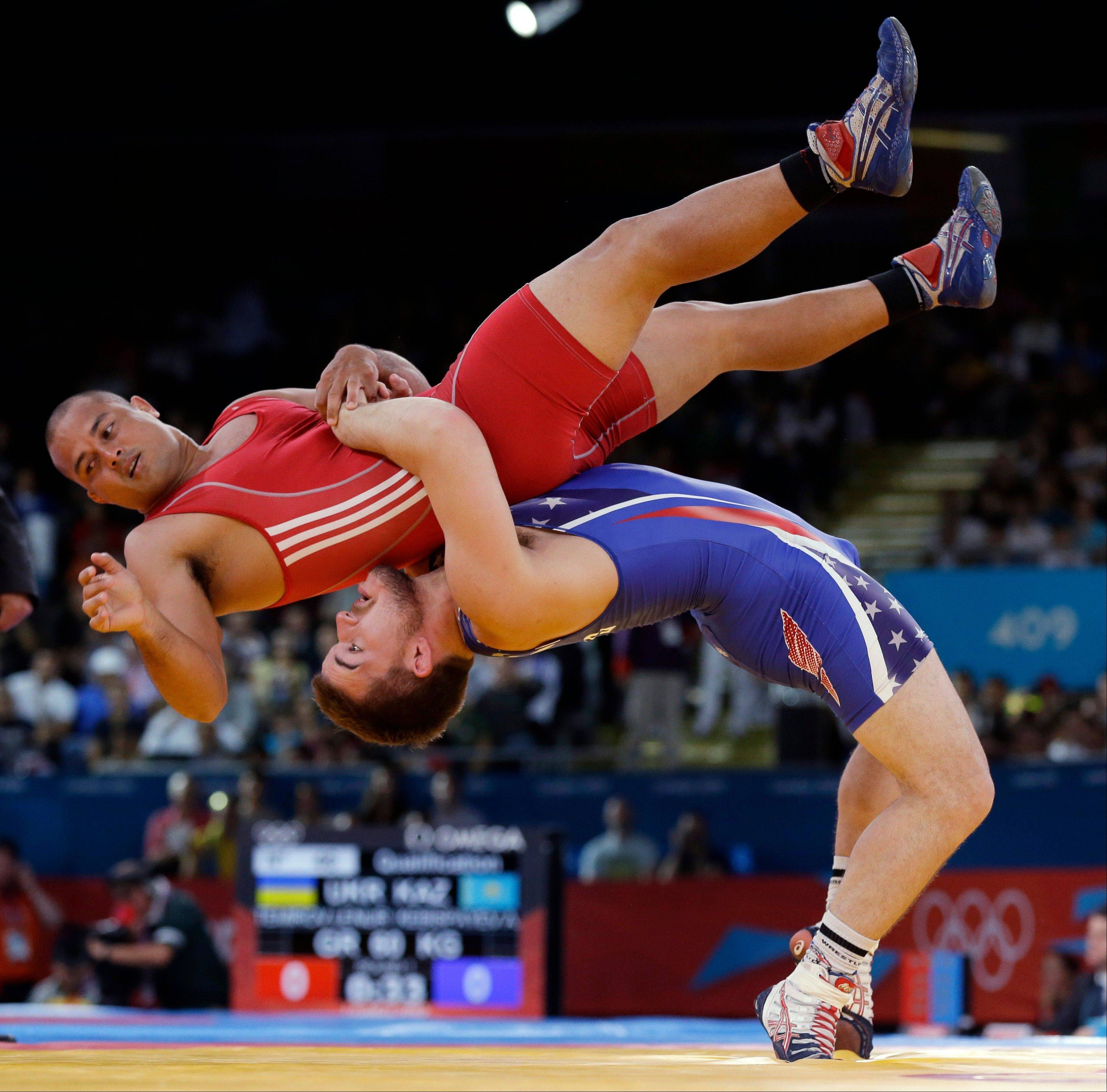 Keitani Graham of Micronesia competes against Charles Edward Betts of the United States, right, during the 84-kg Greco-Roman wrestling competition at the 2012 Summer Olympics, Monday, Aug. 6, 2012, in London.