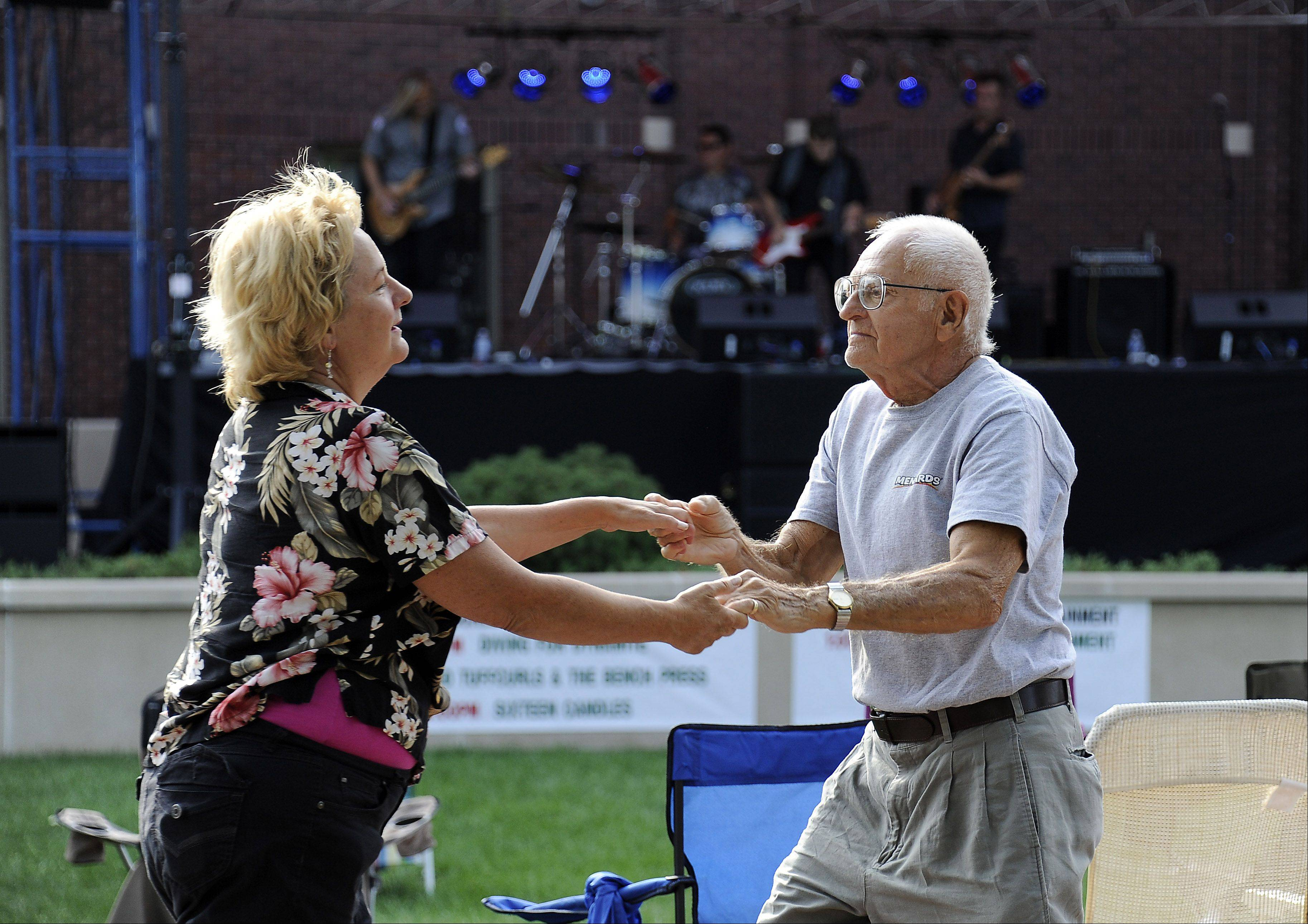 Steve Tarzon and Winnie Franzak of Mt. Prospect enjoy the music from the band Diving for Dynamite at Mt. Prospect's block party on Friday.