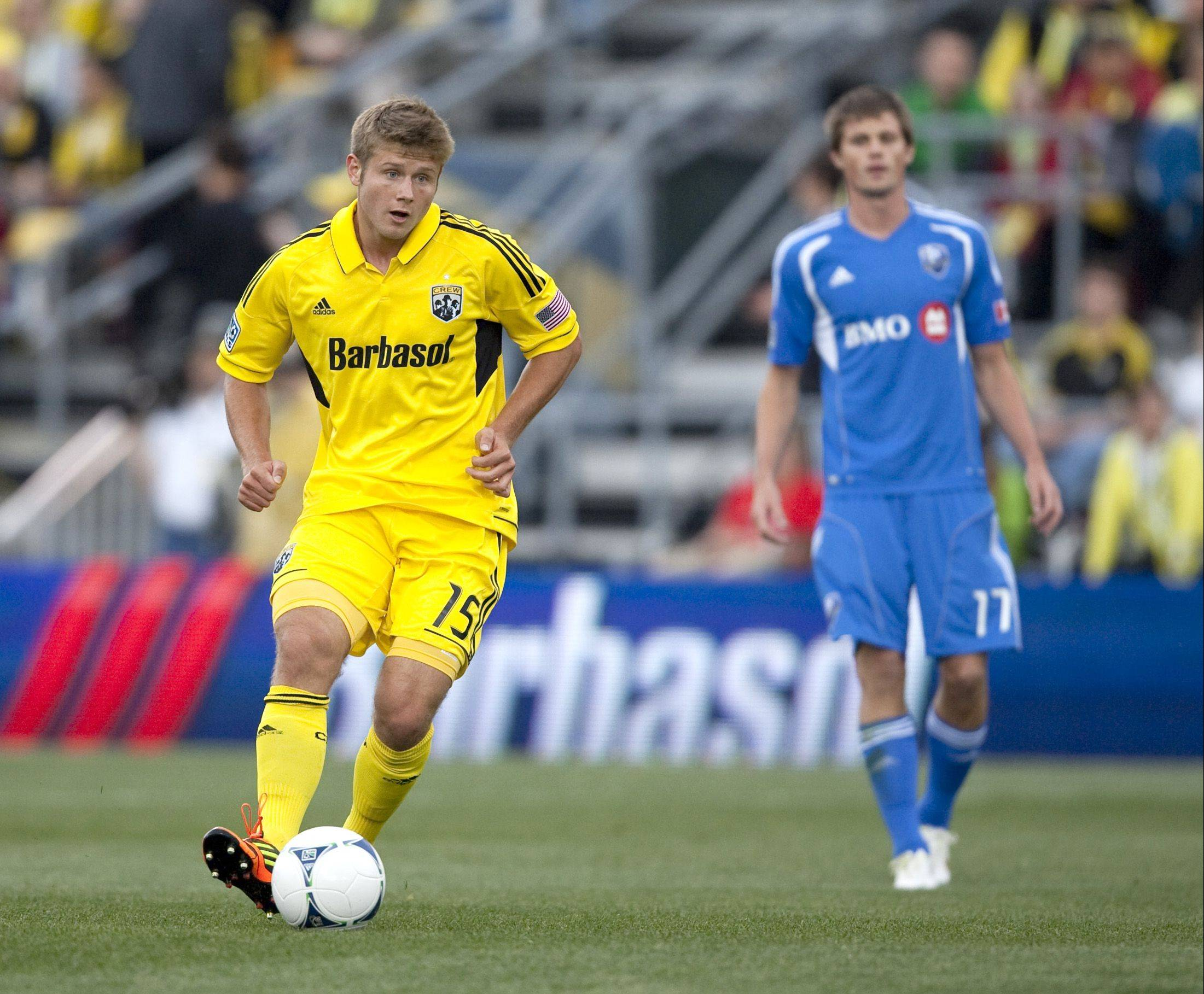 Columbus Crew midfielder Kirk Urso, left, handles the ball against the Montreal Impact in the opening game of the MLS season at Crew Stadium in Columbus on March 24, 2012. Urso died at an Ohio hospital after collapsing at a restaurant/bar early Sunday.