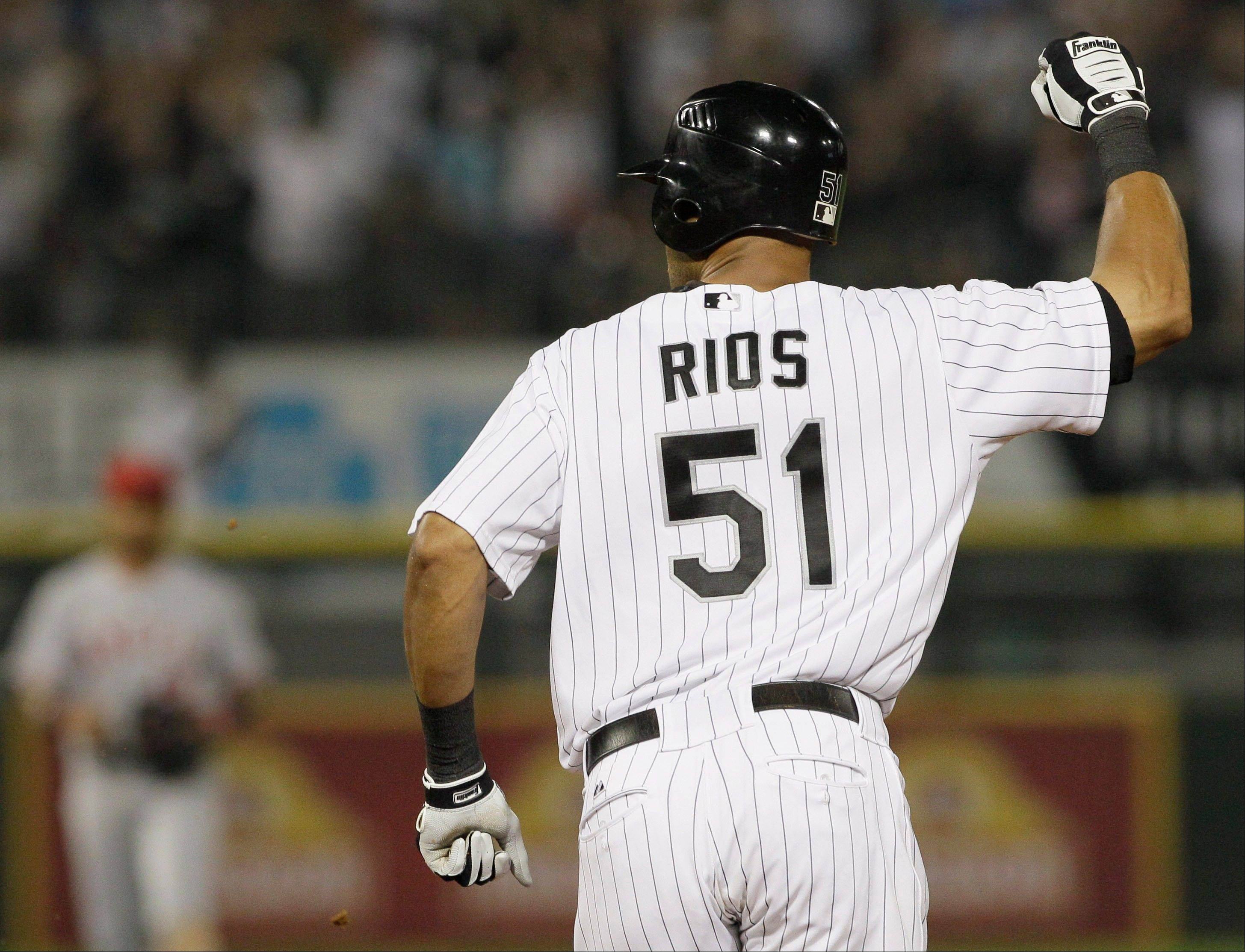 White Sox right fielder Alex Rios celebrates as he rounds the bases after hitting a two-run game-winning home run during the 10th inning Friday against the Los Angeles Angels.