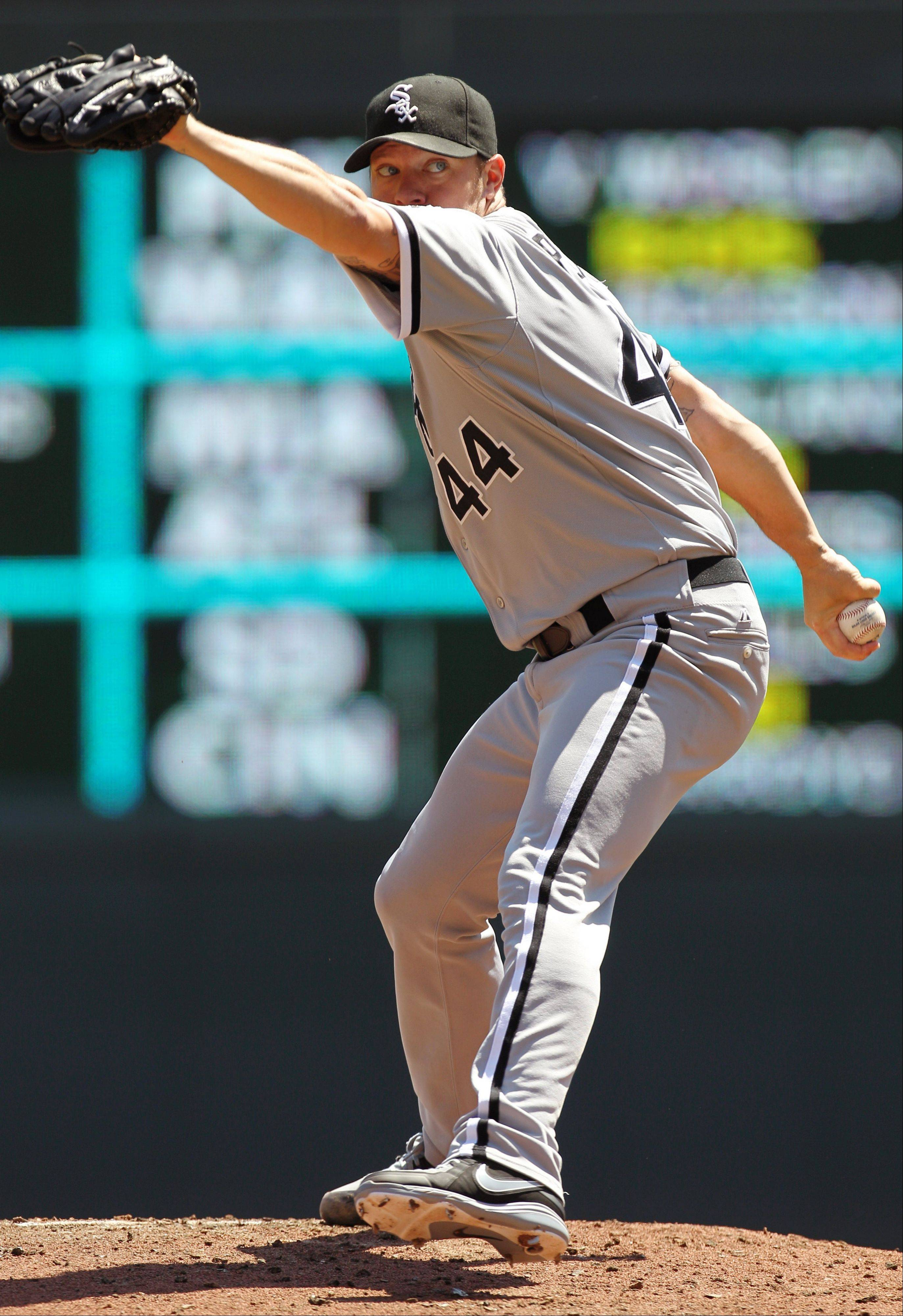 Pitcher Jake Peavy throws against the Minnesota Twins during the second inning of a baseball game, Wednesday, Aug. 1, 2012, in Minneapolis. (AP Photo/Genevieve Ross)