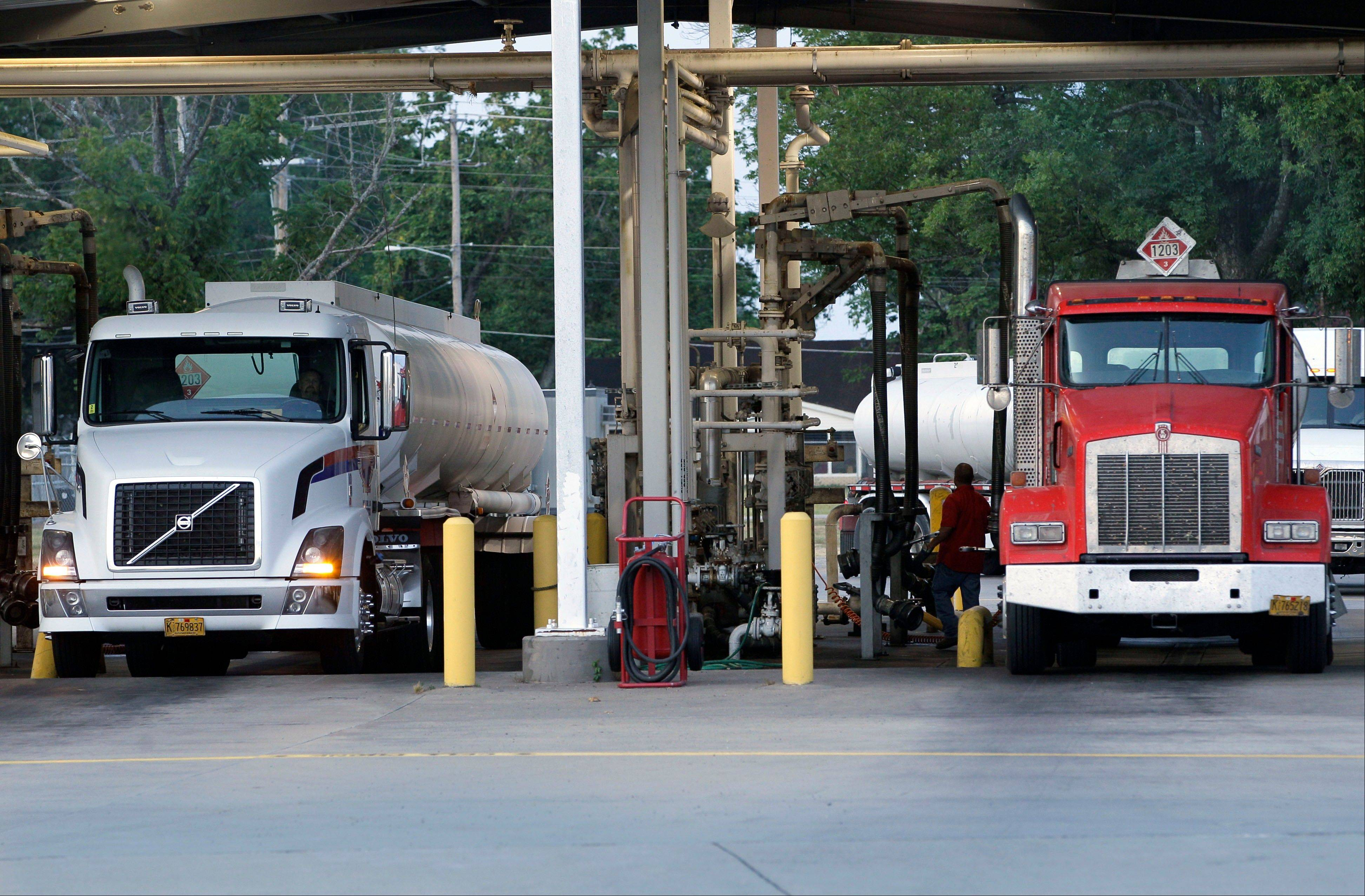 Fuel tanker trucks arrive at a North Little Rock, Ark., petroleum distributorship before making daily deliveries to gasoline retailers.Oil slipped slightly to almost $91 a barrel Monday, but managed to hold on to most of the big gains from the previous session after the U.S. reported better-than-expected jobs growth.