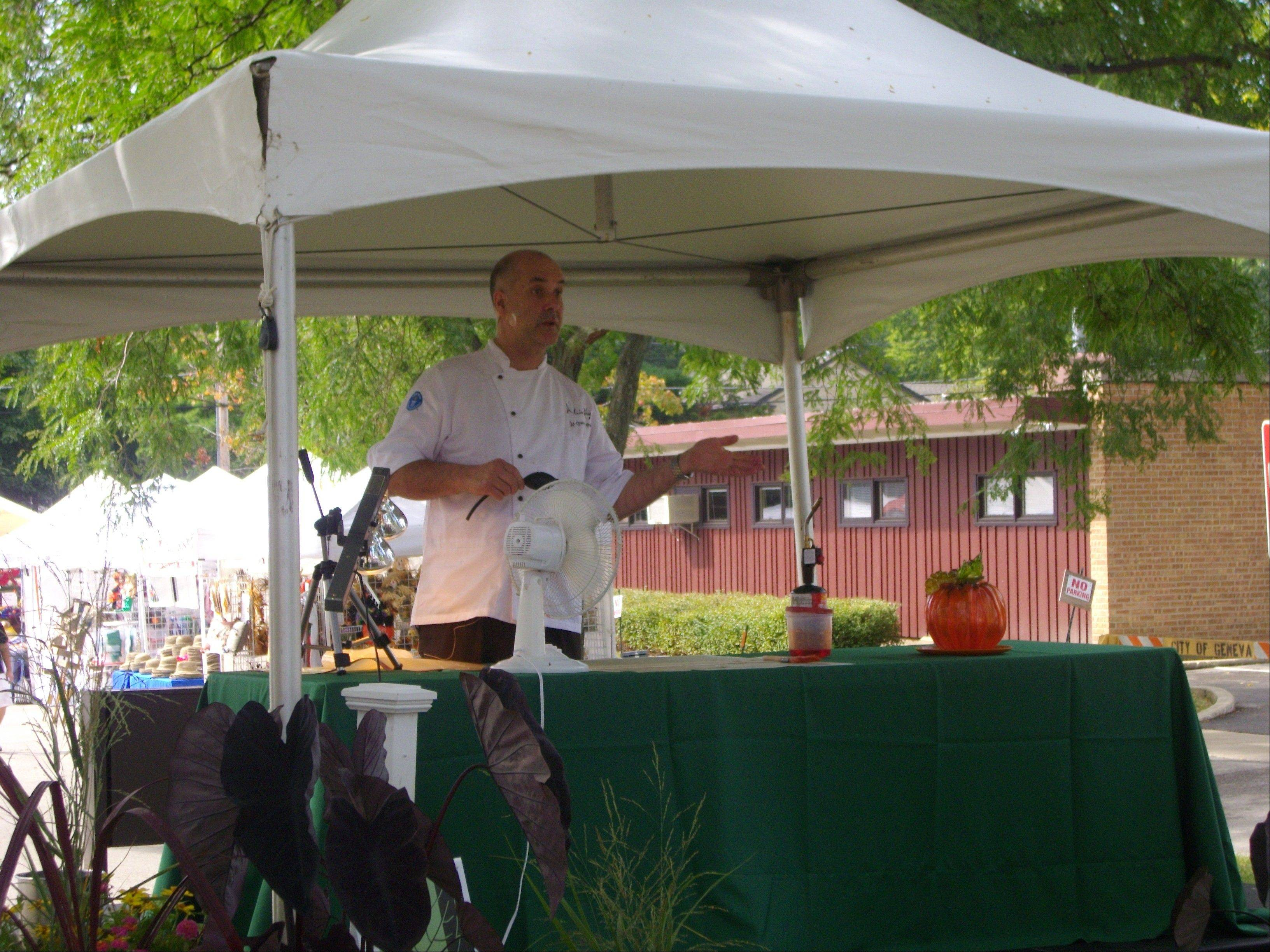 Chef Alain Roby talks at the 2011 Festival of the Vine demonstration stage. His All Chocolate Kitchen in Geneva marked its anniversary.