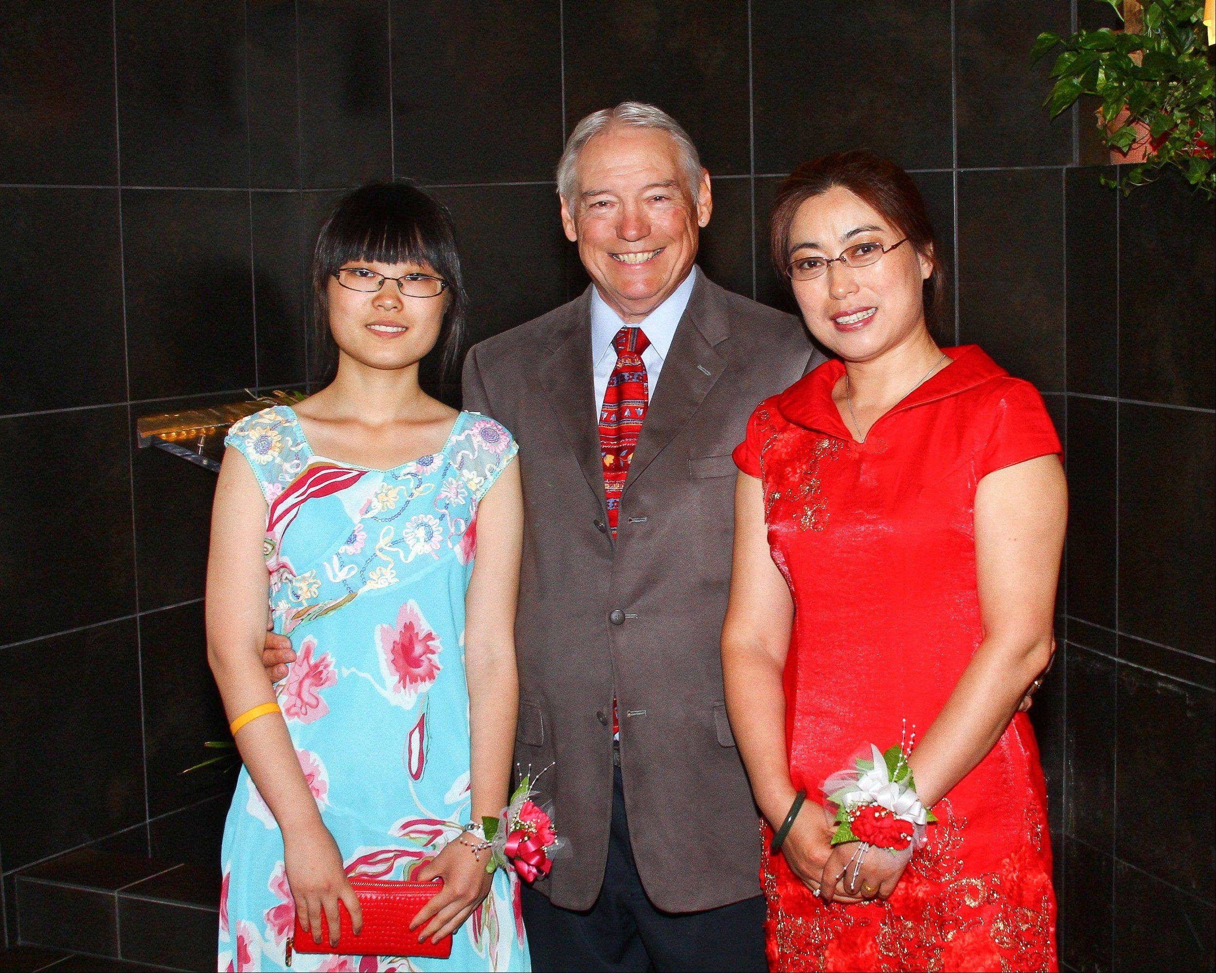 Ray Wright, professor at Roosevelt University, recently married Yane Zhang, at right. Her daughter, Jingwen Sun, also attended.