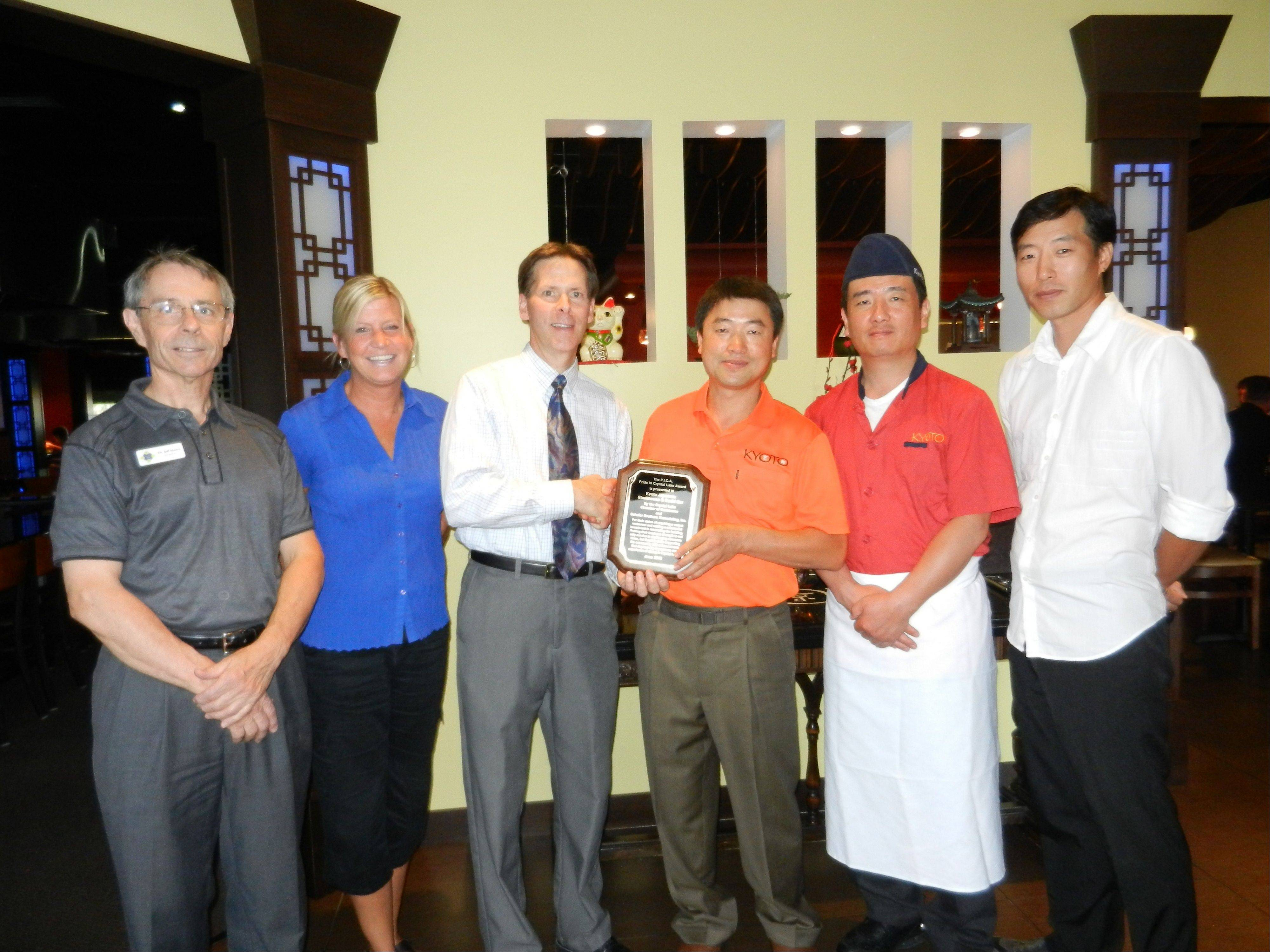 Kyoto Japanese Steakhouse and Sushi Bar received the Crystal Lake Chamber's Pride in Crystal Lake Award. Jeffrey Moore; (left) Sharon Repplinger; Gary Reece, Crystal Lake Chamber of Commerce President; Owner Shawn Lee; Head Chef Gilhoon Bang and General Manager James Shim.