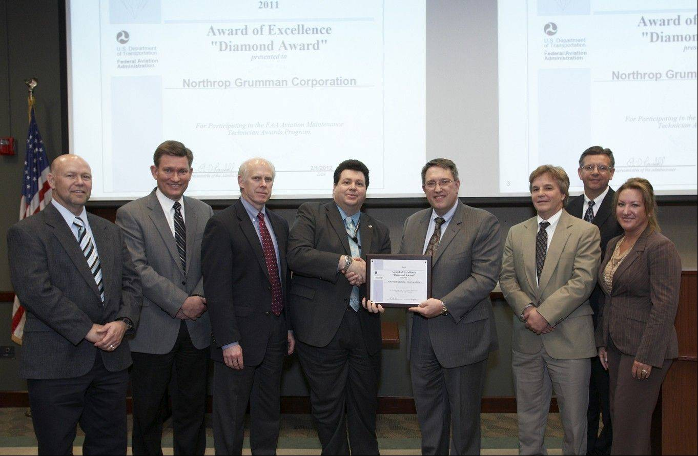 Northrop Grumman receives a second consecutive FAA Diamond Award for Excellence for promoting training and safety at its FAA certified repair station. From left are: Raymond Stickney, FAA aviation safety inspector; Wayne Melzer, Northrop Grumman International IRCM program manager; David Denton, Northrop Grumman director of international IRCM; Kurt Lawson, Northrop Grumman logistics program manager; George Wadsworth, FAA Great Lakes division assistant manager; Tim Sokol, FAA Safety Team program manager; John Sidor, Northrop Grumman director of mission assurance; and Lisa Strama, Northrop Grumman director of operations.