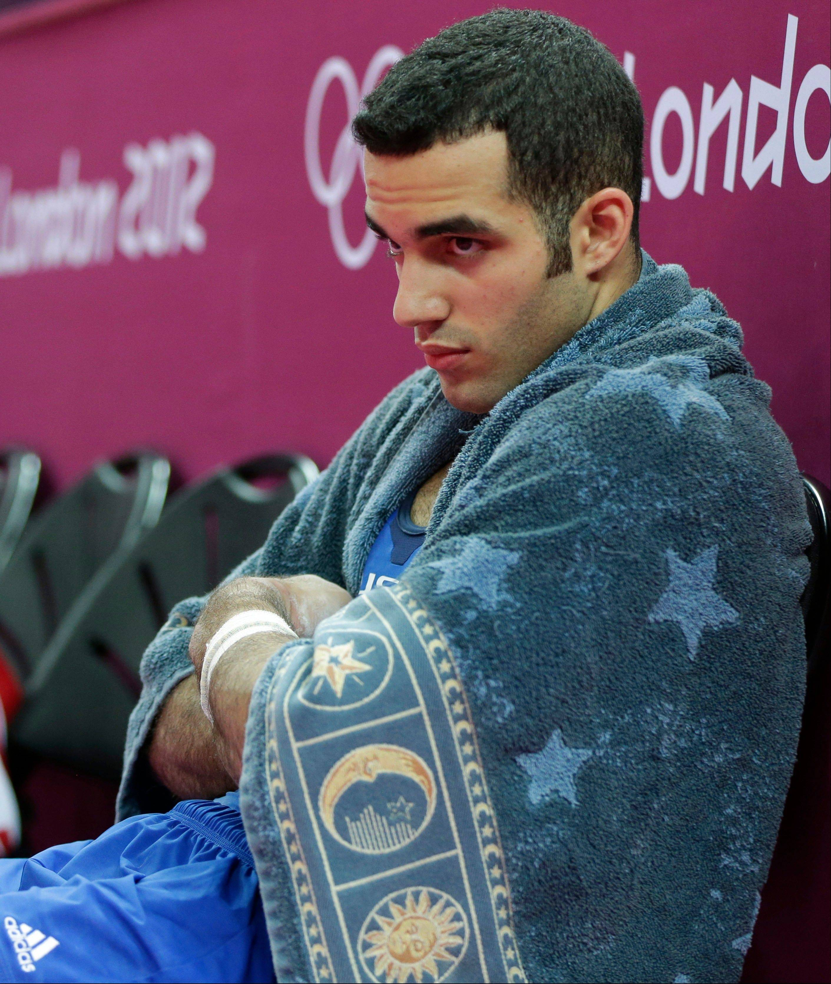 U.S. gymnast Danell Leyva sits dejected after a performance during the artistic gymnastics men's individual all-around competition at the 2012 Summer Olympics.