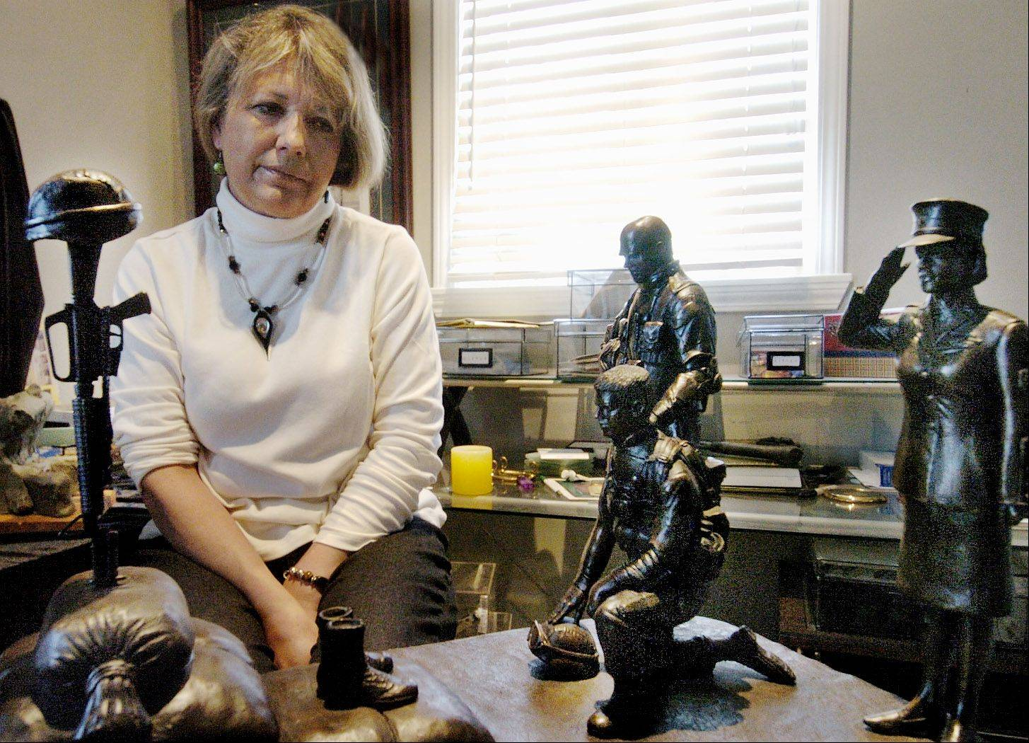 Sculptor Cindy Seng was supposed to create the bronze statues of the troops