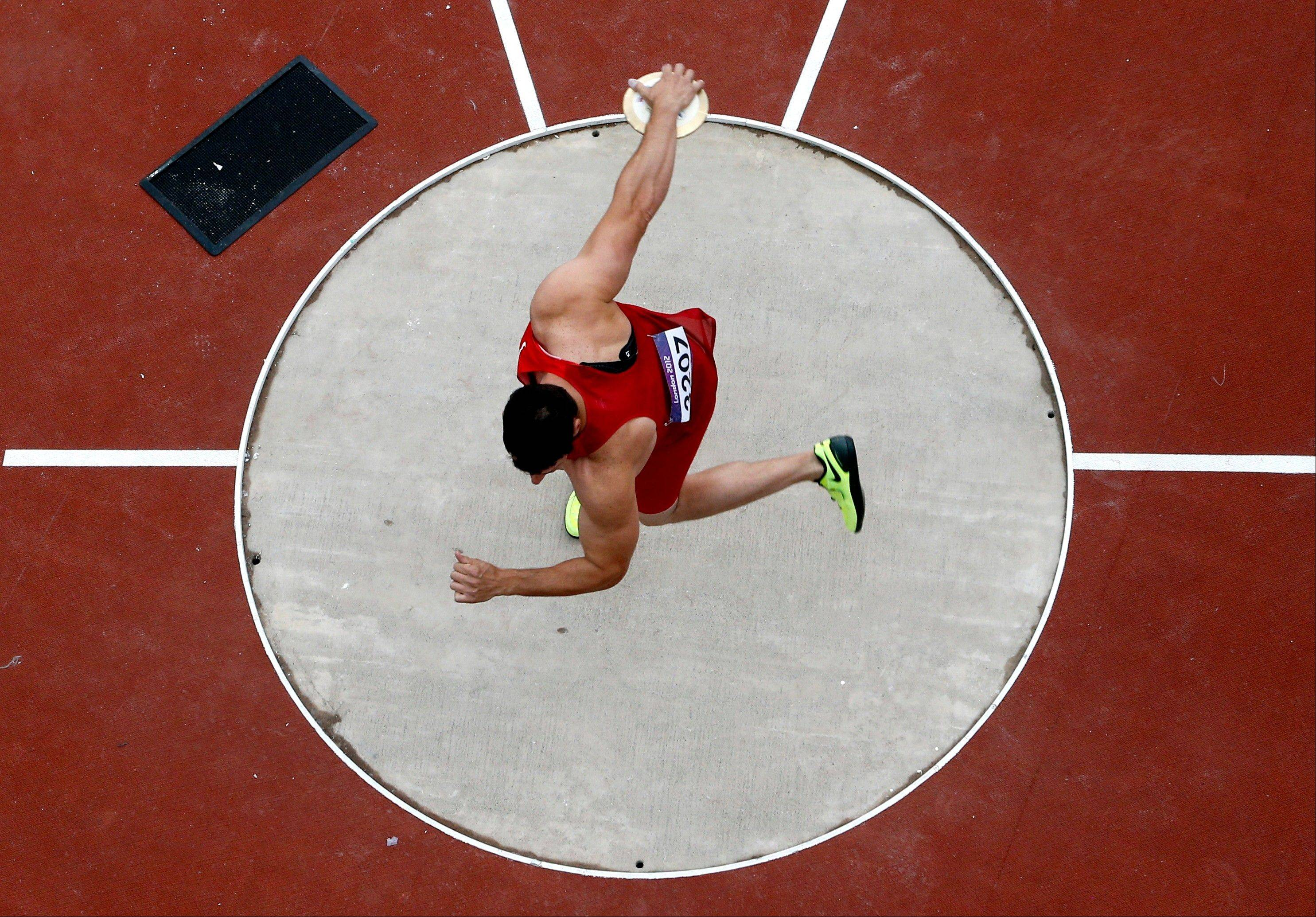 Lance Brooks competes in the men's discus qualification during athletics competitions at the Olympic Stadium Monday.
