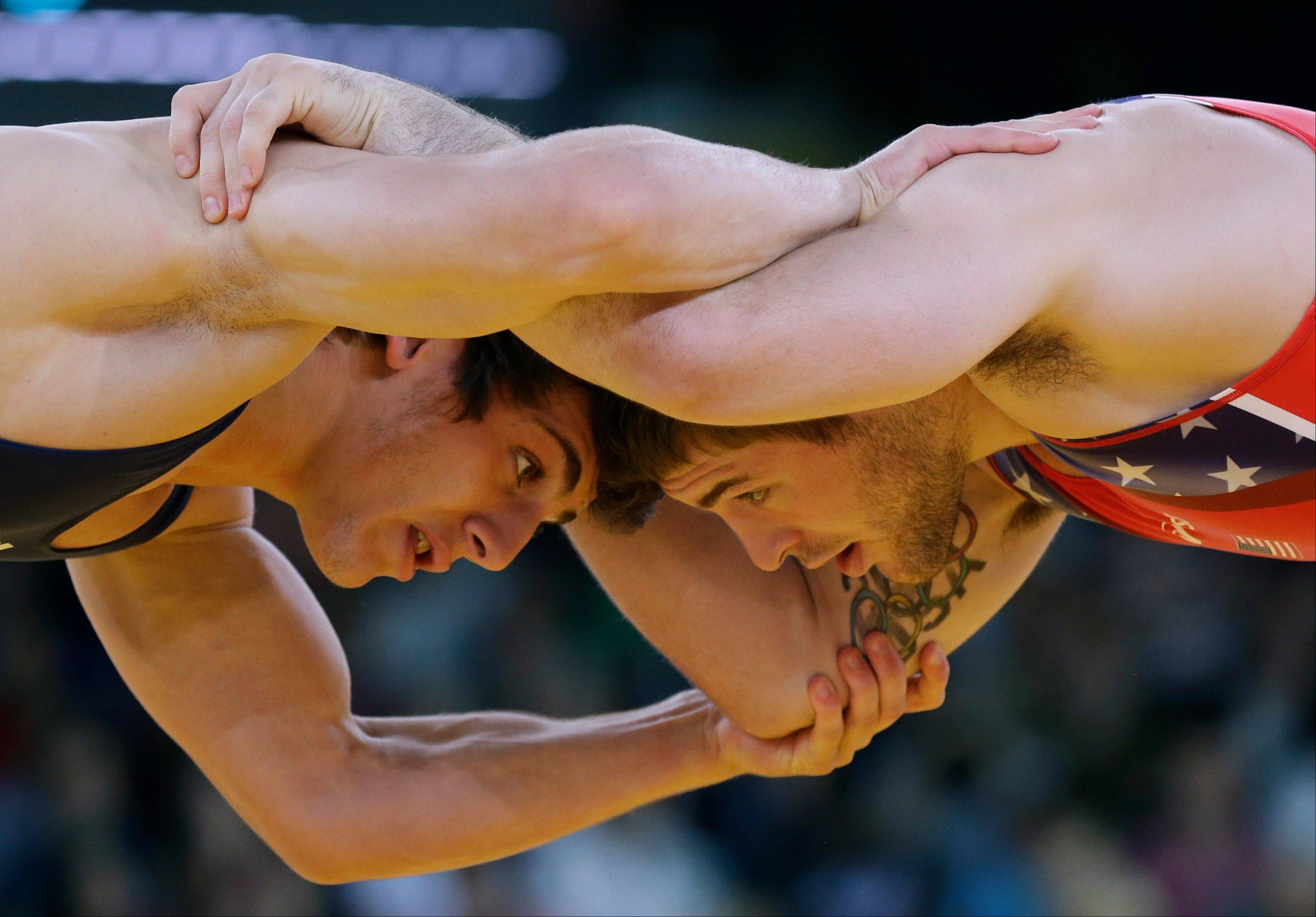 United States' Benjamin Provisor, right, competes with Georgia's Zurabi Datunashvili during the 74-kg Greco-Roman wrestling competition at the 2012 Summer Olympics, Sunday, Aug. 5, 2012, in London.
