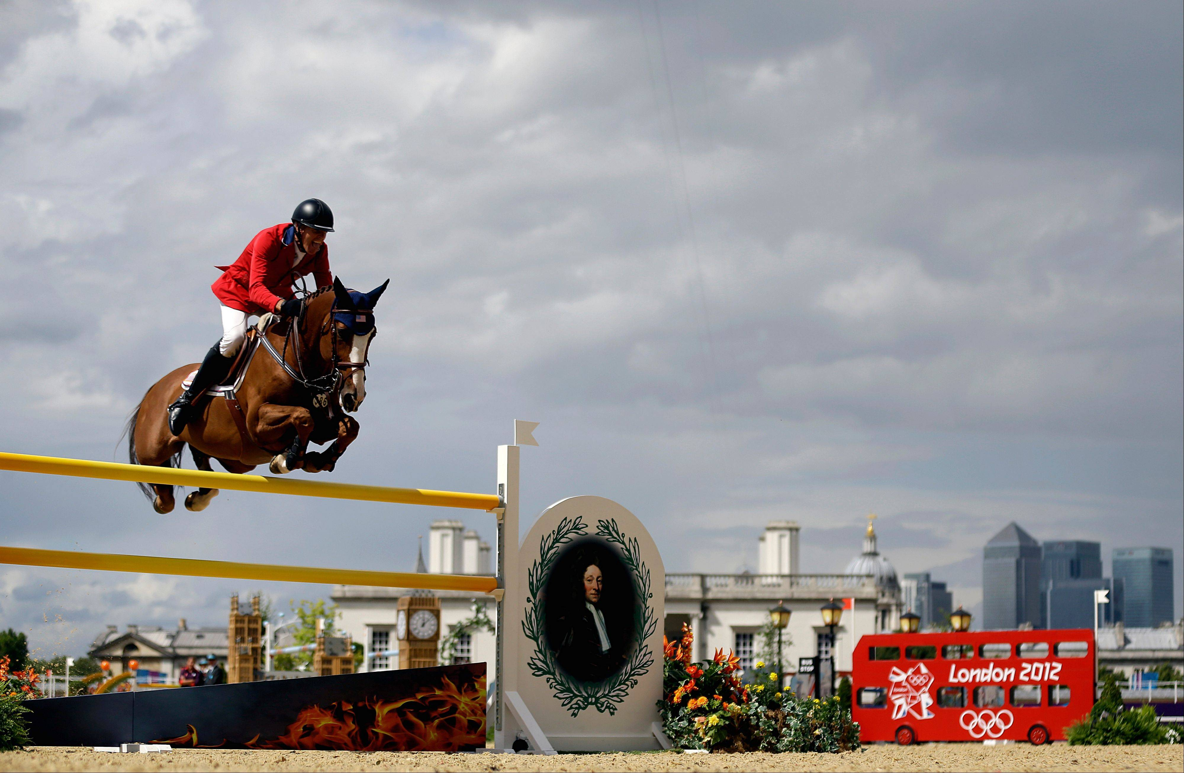 Richard Fellers, of the United States, rides his horse Flexible in the equestrian show jumping team competition at the 2012 Summer Olympics, Sunday, Aug. 5, 2012, in London.