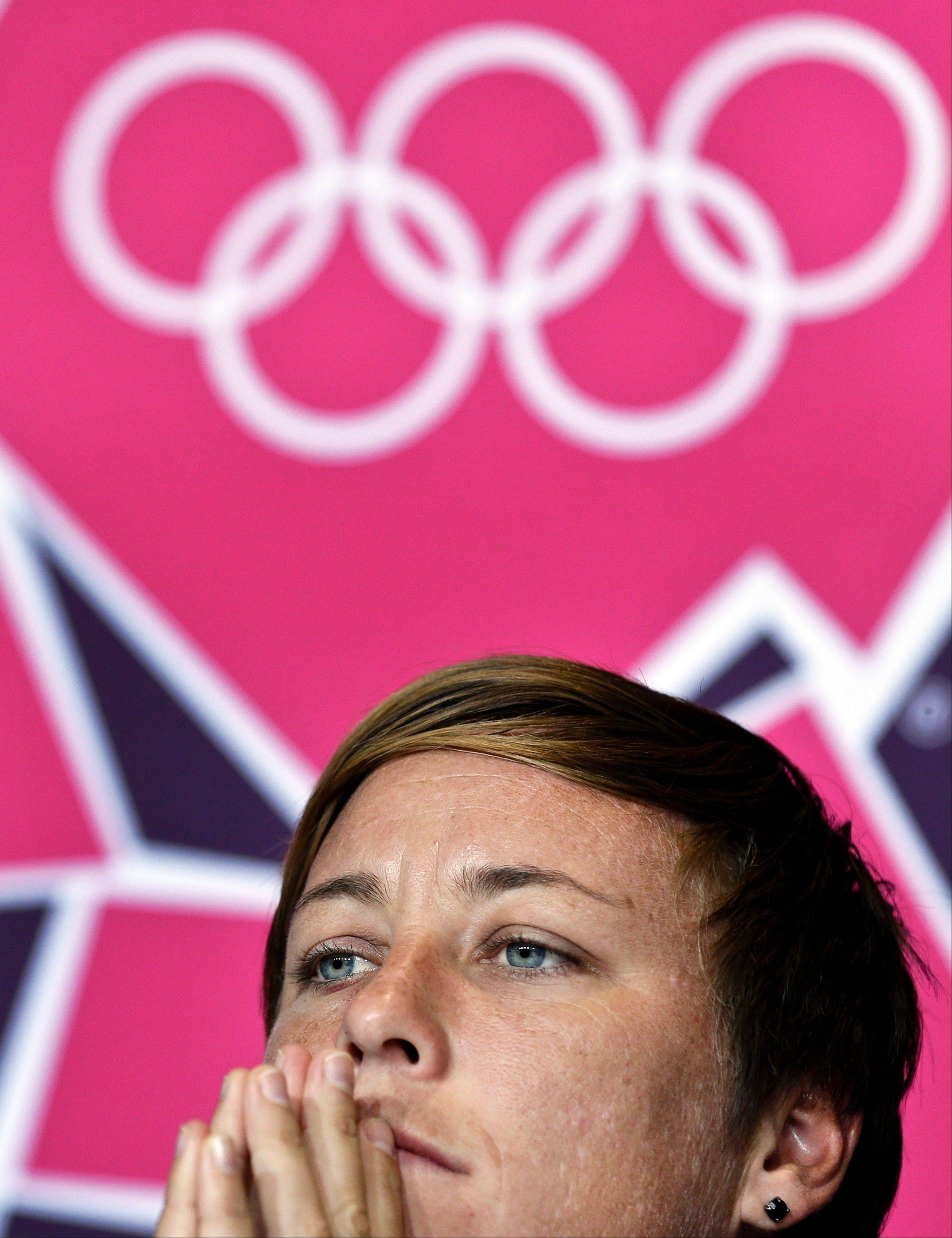 United States' Abby Wambach listens to a reporter's question during a women's soccer news conference for the 2012 Summer Olympics, Sunday, Aug. 5, 2012, at Old Trafford in Manchester, England.
