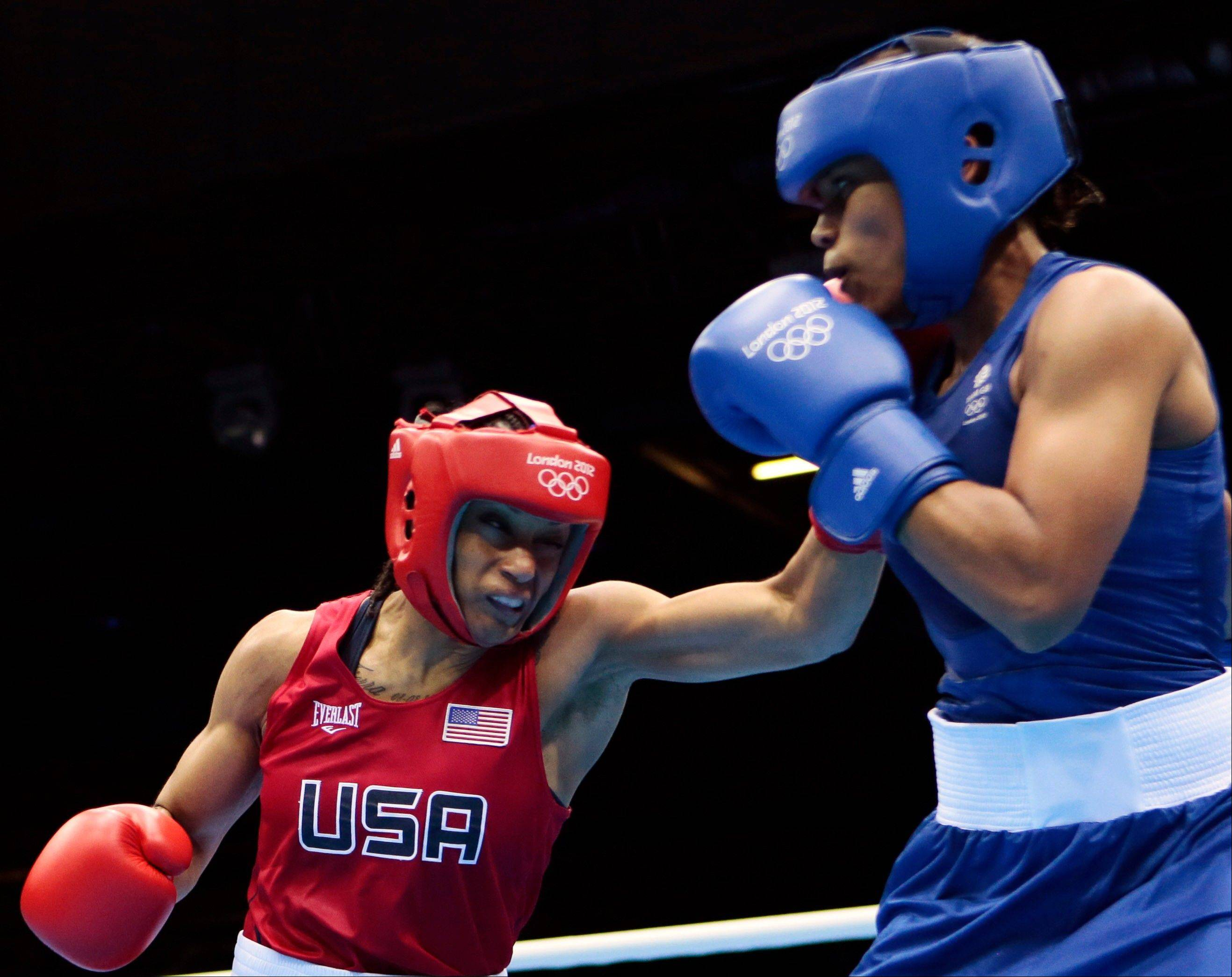 Quanitta Underwood of the United States, left, and Natasha Jonas of Great Britain, fight during the women's lightweight boxing competition at the 2012 Summer Olympics, Sunday, Aug. 5, 2012, in London.