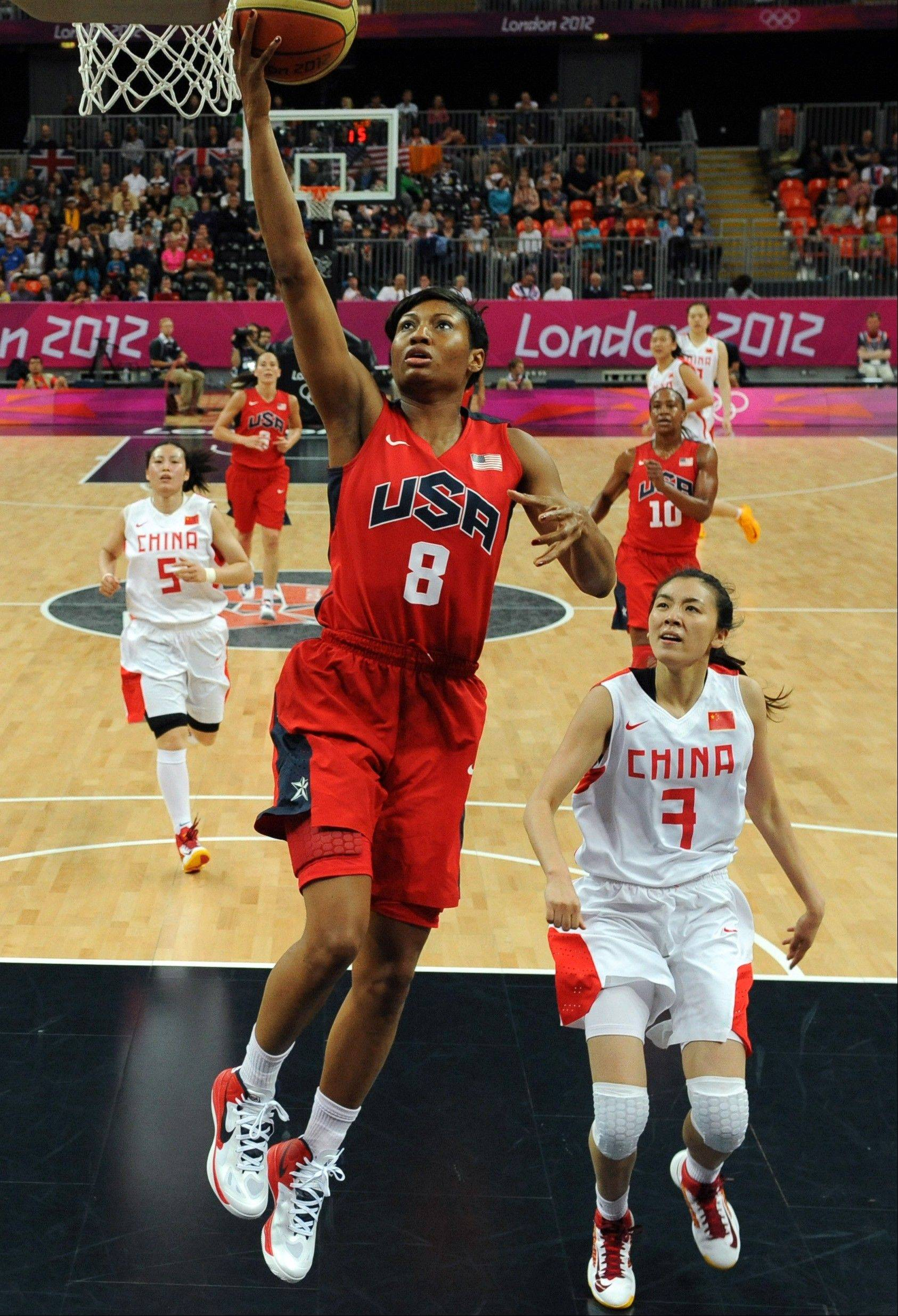 China's Zhao Shuang (7) watches United States' Angel McCoughtry (8) shoot during their women's preliminary round basketball game at the 2012 Summer Olympics on Sunday, Aug. 5, 2012, in London.