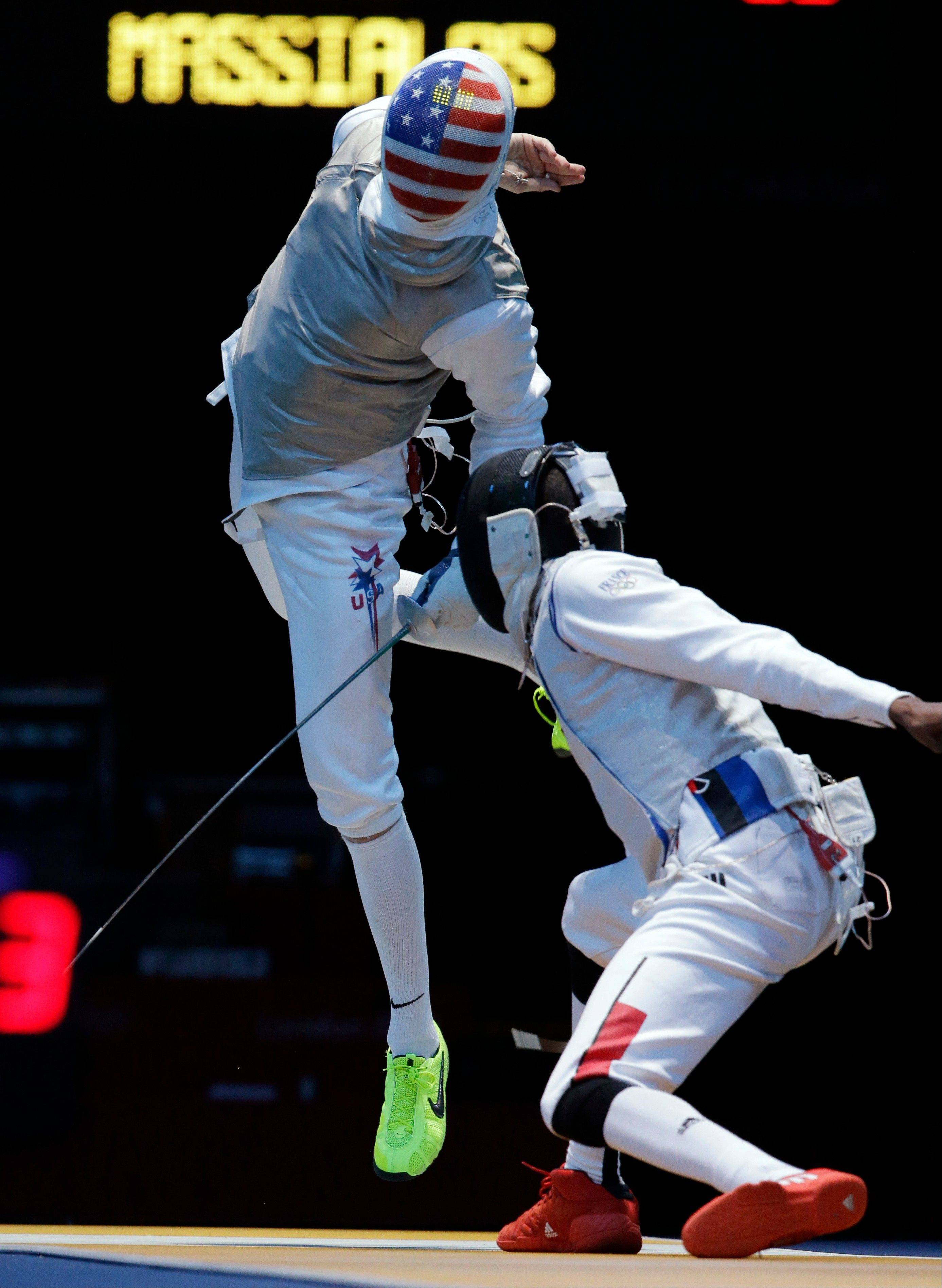 Race Imboden of the United States, left, competes against Enzo Lefort of France during the men's foil team fencing competition at the 2012 Summer Olympics, Sunday, Aug. 5, 2012, in London.