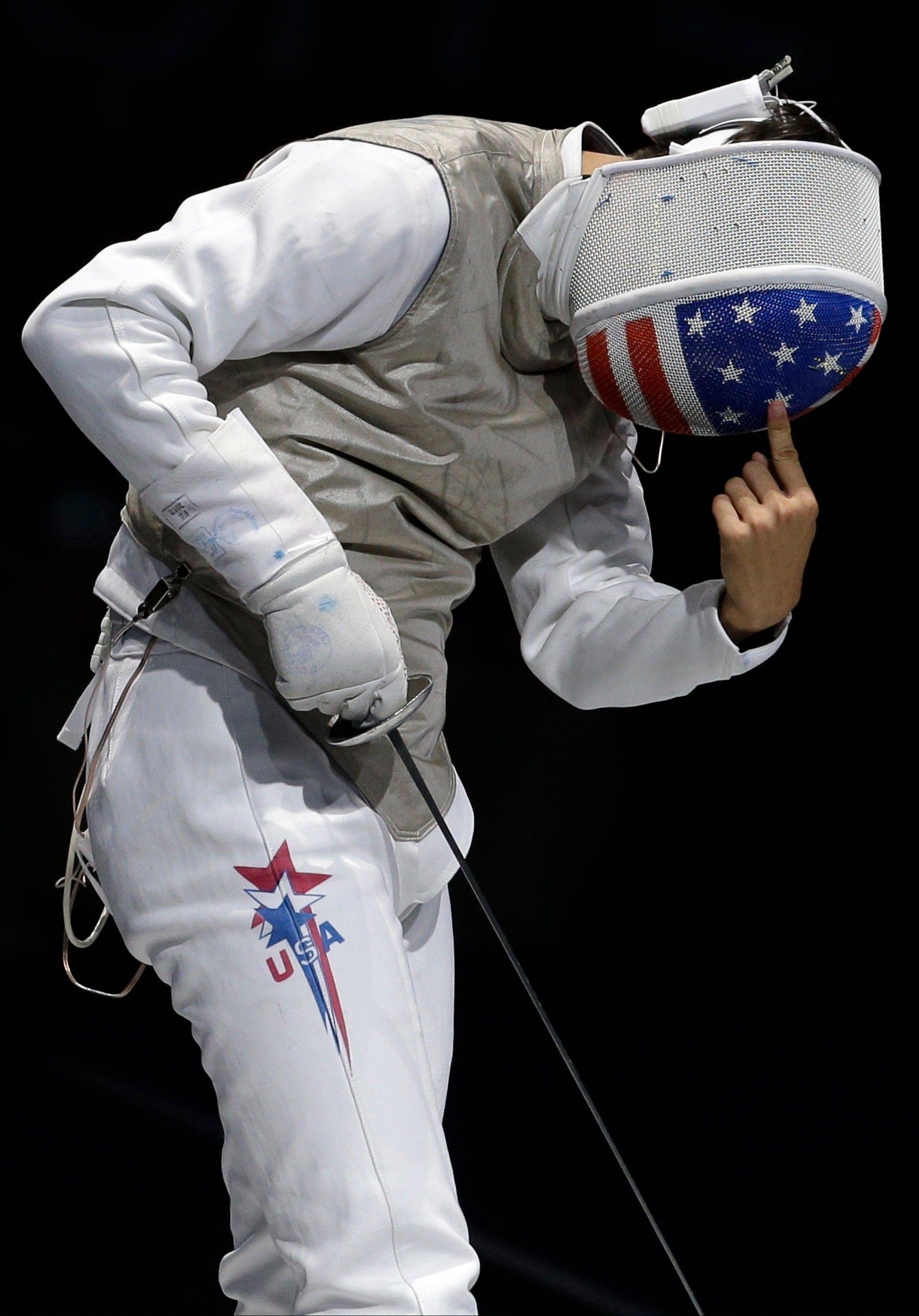 Alexander Massialas of the United States reacts while competing against Sebastian Bachman of Germany in the bronze medal match during the men's foil team fencing competition at the 2012 Summer Olympics, Sunday, Aug. 5, 2012, in London.