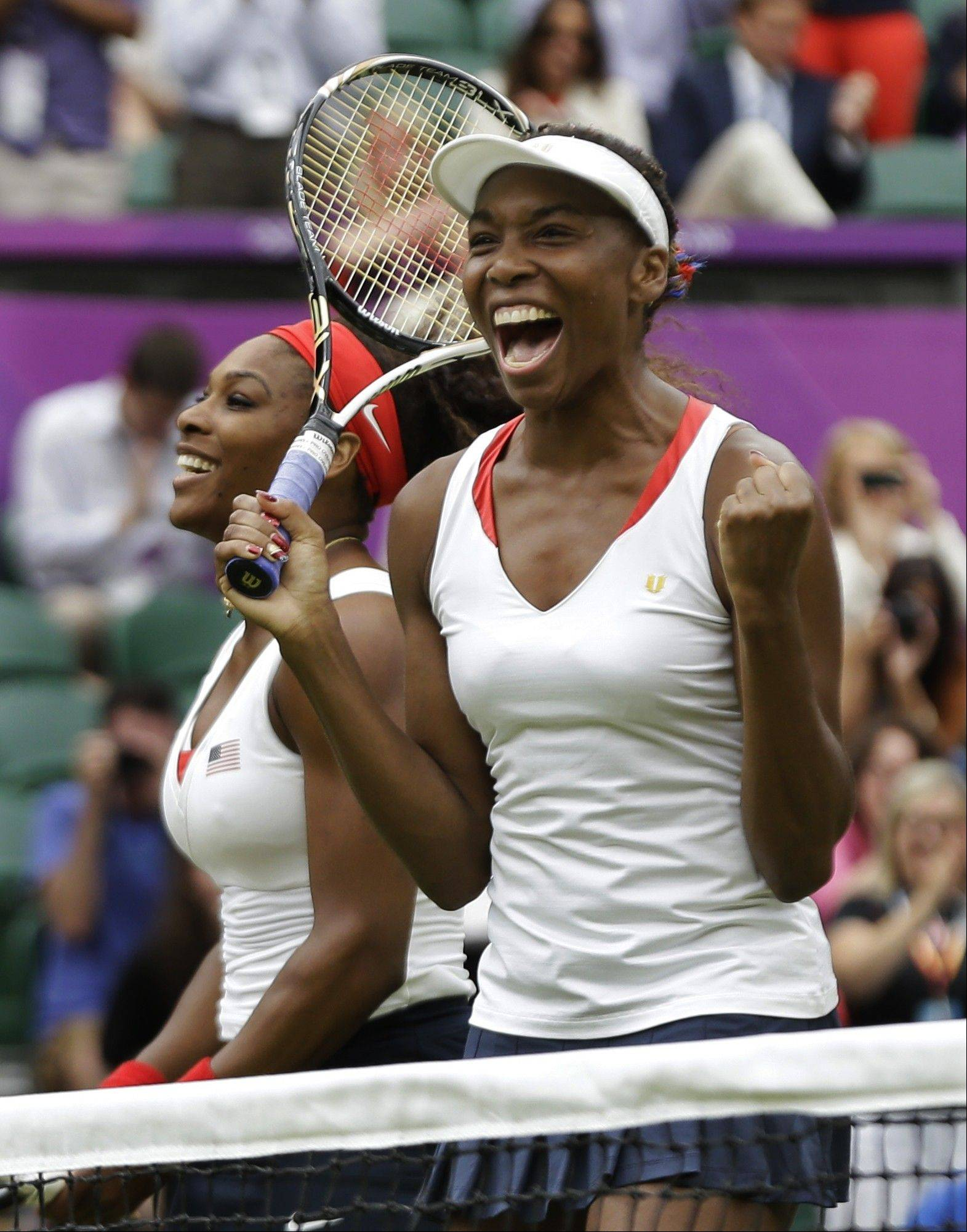 Venus Williams, right, and Serena Williams of the United States celebrate their victory against Andrea Hlavackova and Lucie Hradecka of the Czech Republic during the gold medal women's doubles match at the All England Lawn Tennis Club in Wimbledon, London at the 2012 Summer Olympics, Sunday, Aug. 5, 2012.