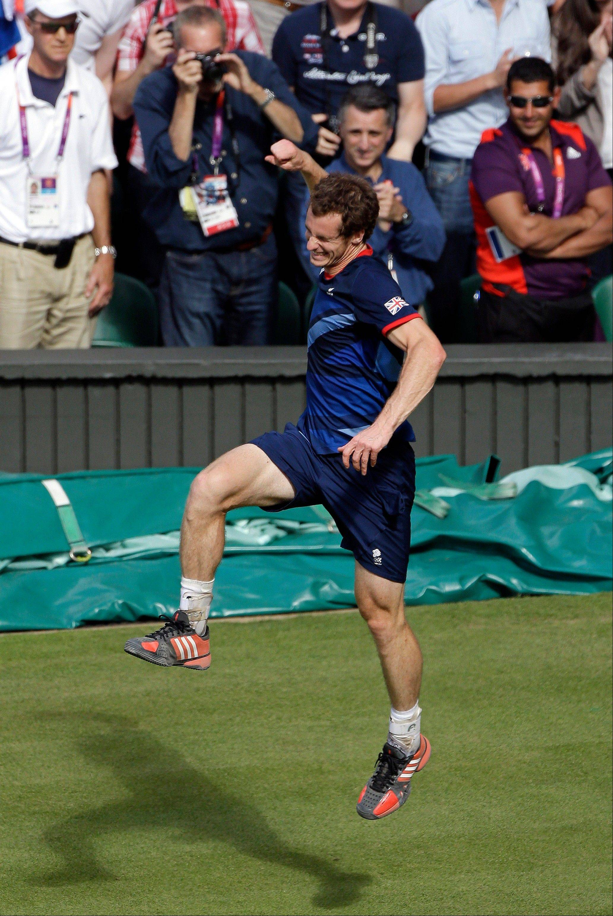 Andy Murray of Great Britain celebrates after defeating Roger Federer of Switzerland in the men's singles gold medal match at the All England Lawn Tennis Club at Wimbledon, in London, at the 2012 Summer Olympics, Sunday, Aug. 5, 2012.