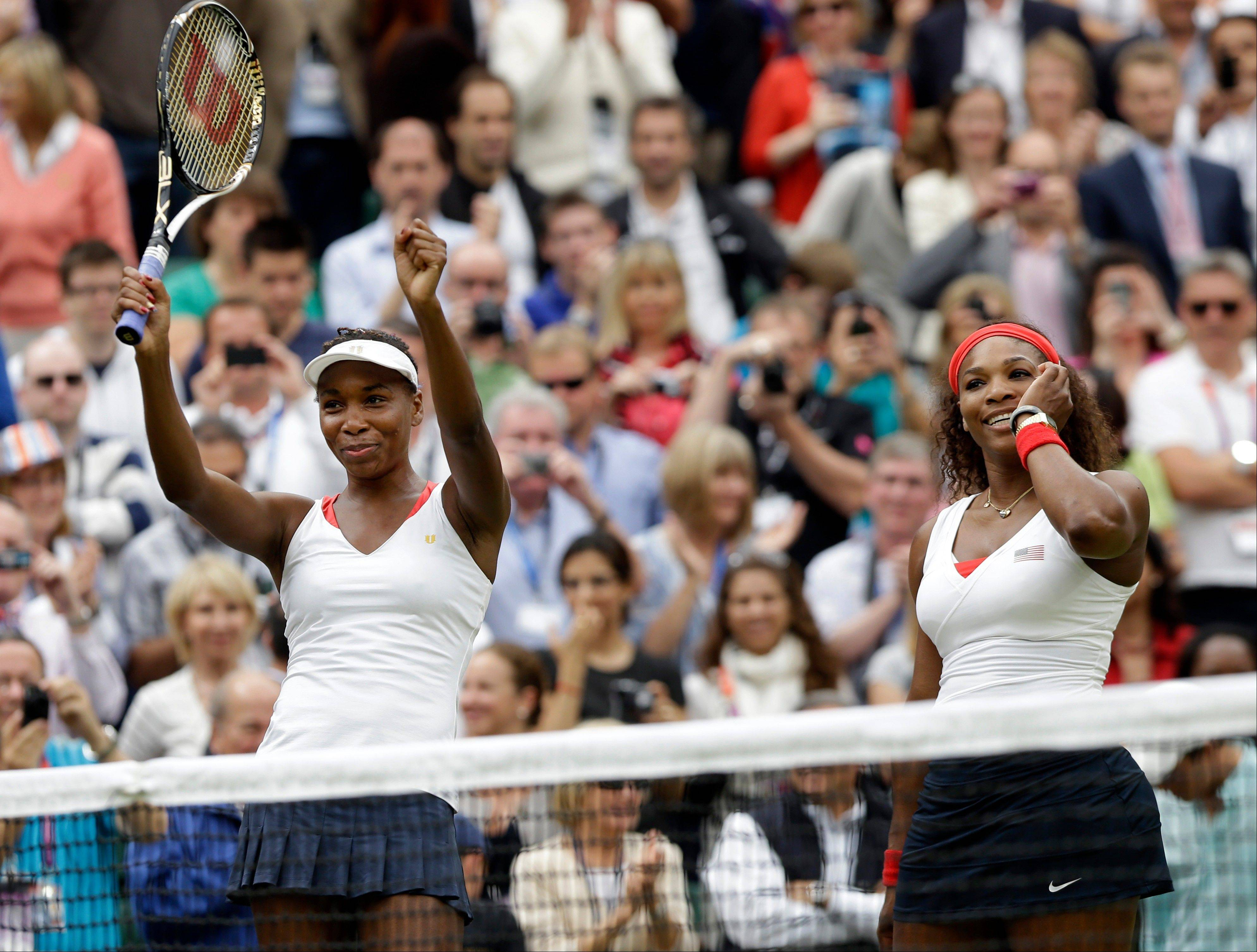 Venus Williams, left, and Serena Williams of the United States celebrate their victory against Andrea Hlavackova and Lucie Hradecka of the Czech Republic in the gold medal women's doubles match at the All England Lawn Tennis Club in Wimbledon, London at the 2012 Summer Olympics, Sunday, Aug. 5, 2012.