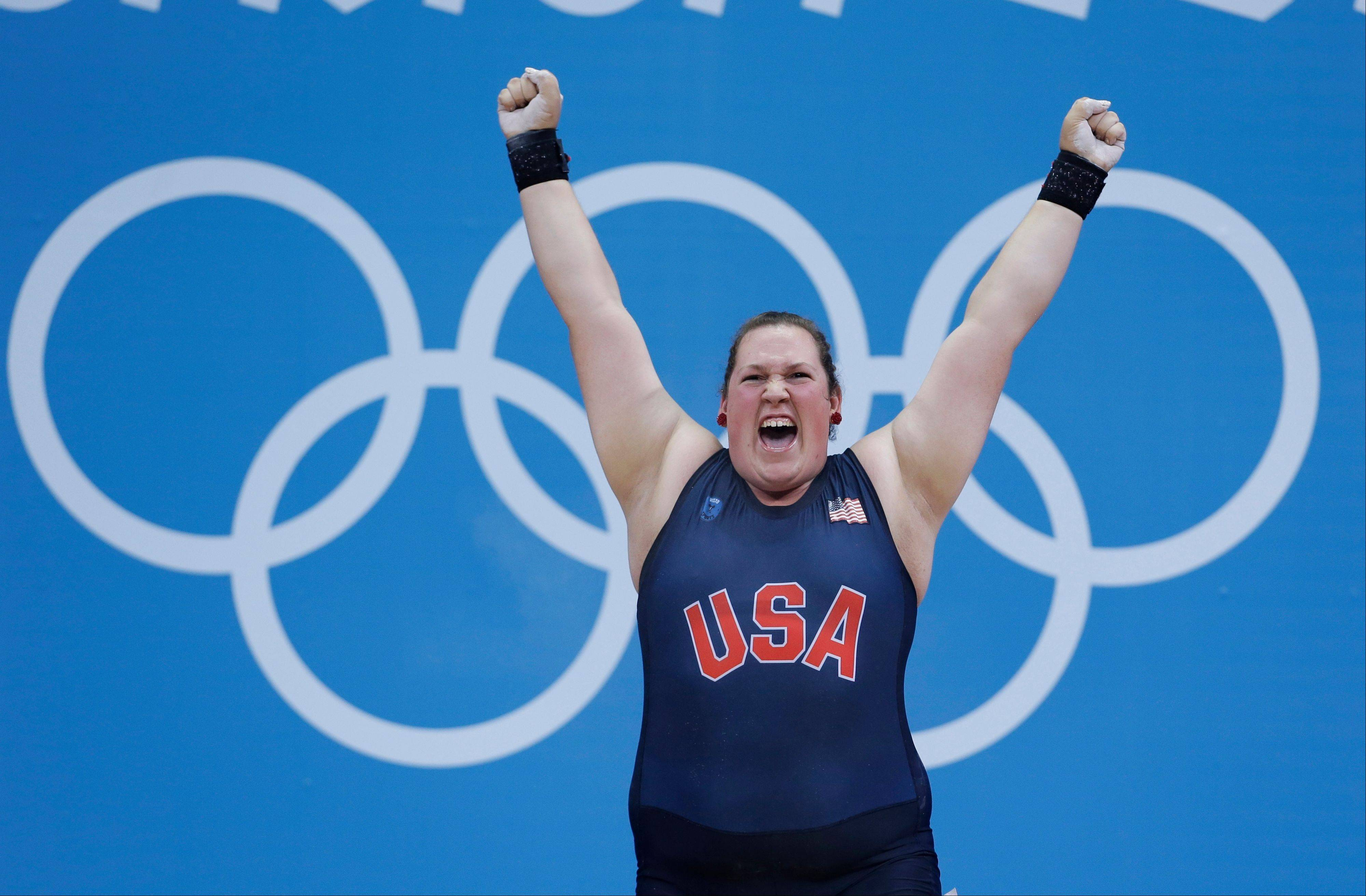 United States' Sarah Robles reacts following a lift during women's +75-kg, weightlifting competition at the 2012 Summer Olympics, Sunday, Aug. 5, 2012, in London.