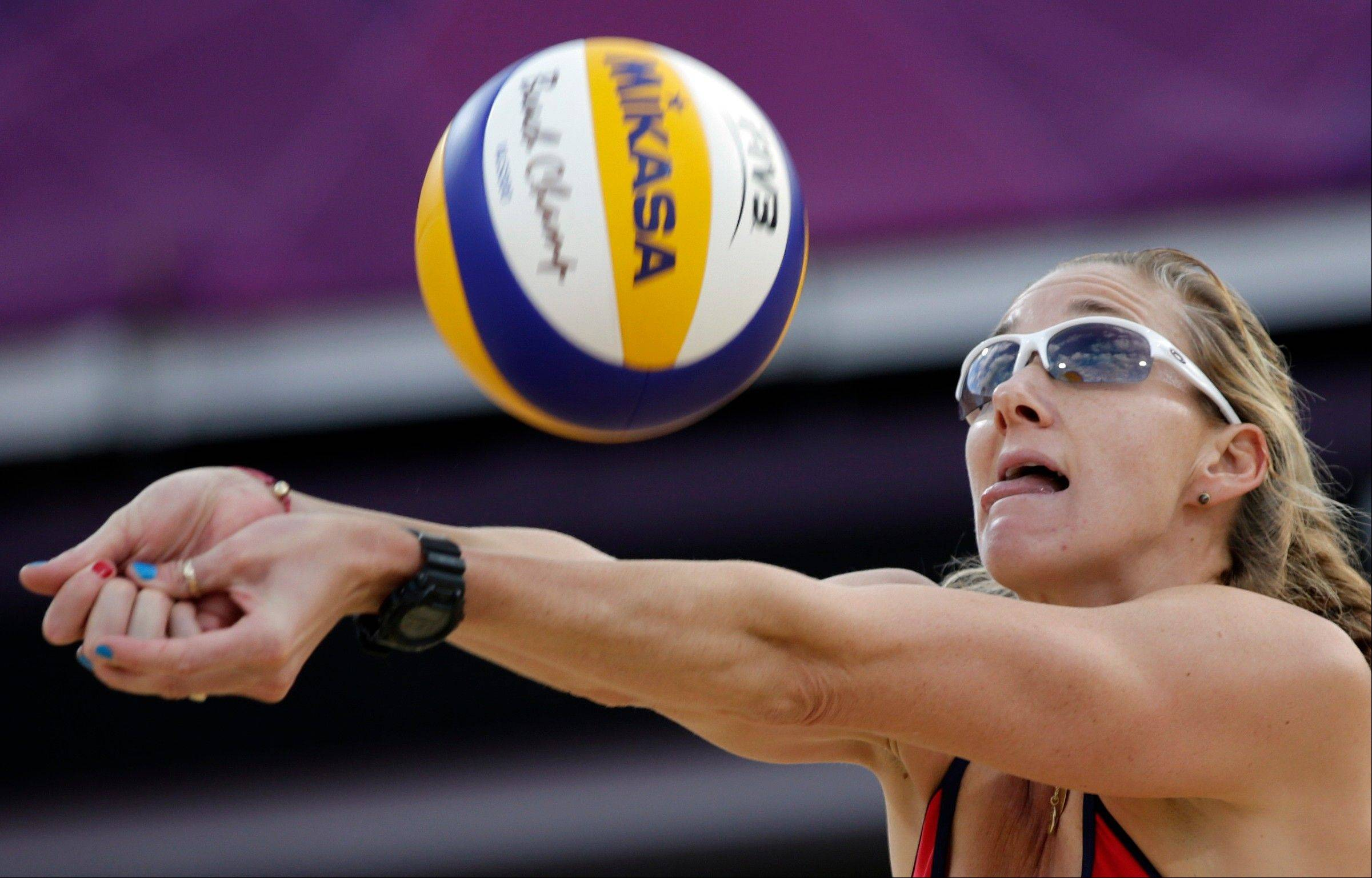 Kerri Walsh of the United States sets the ball during a beach volleyball match against Italy at the 2012 Summer Olympics, Sunday, Aug. 5, 2012, in London.