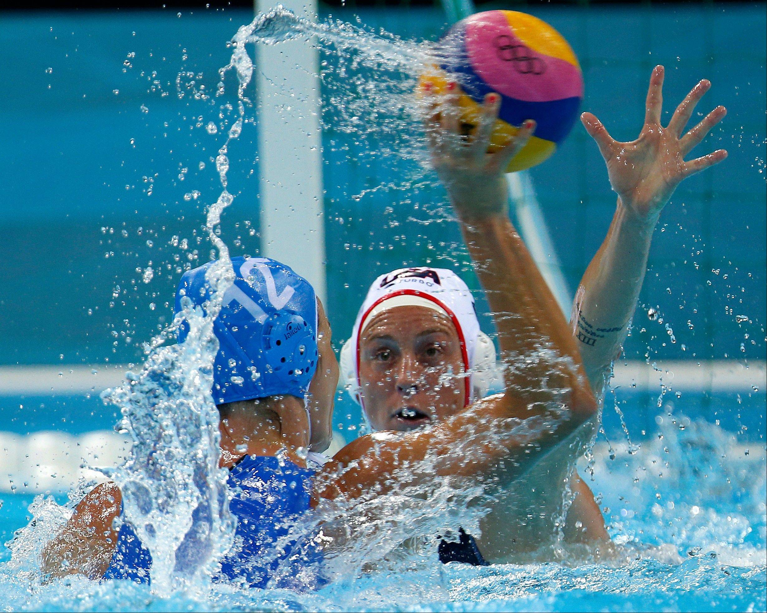 Lauren Wenger, right, of the United States defends against Teresa Frassinetti of Italy during their women's water polo quarterfinal match at the 2012 Summer Olympics, Sunday, Aug. 5, 2012, in London.