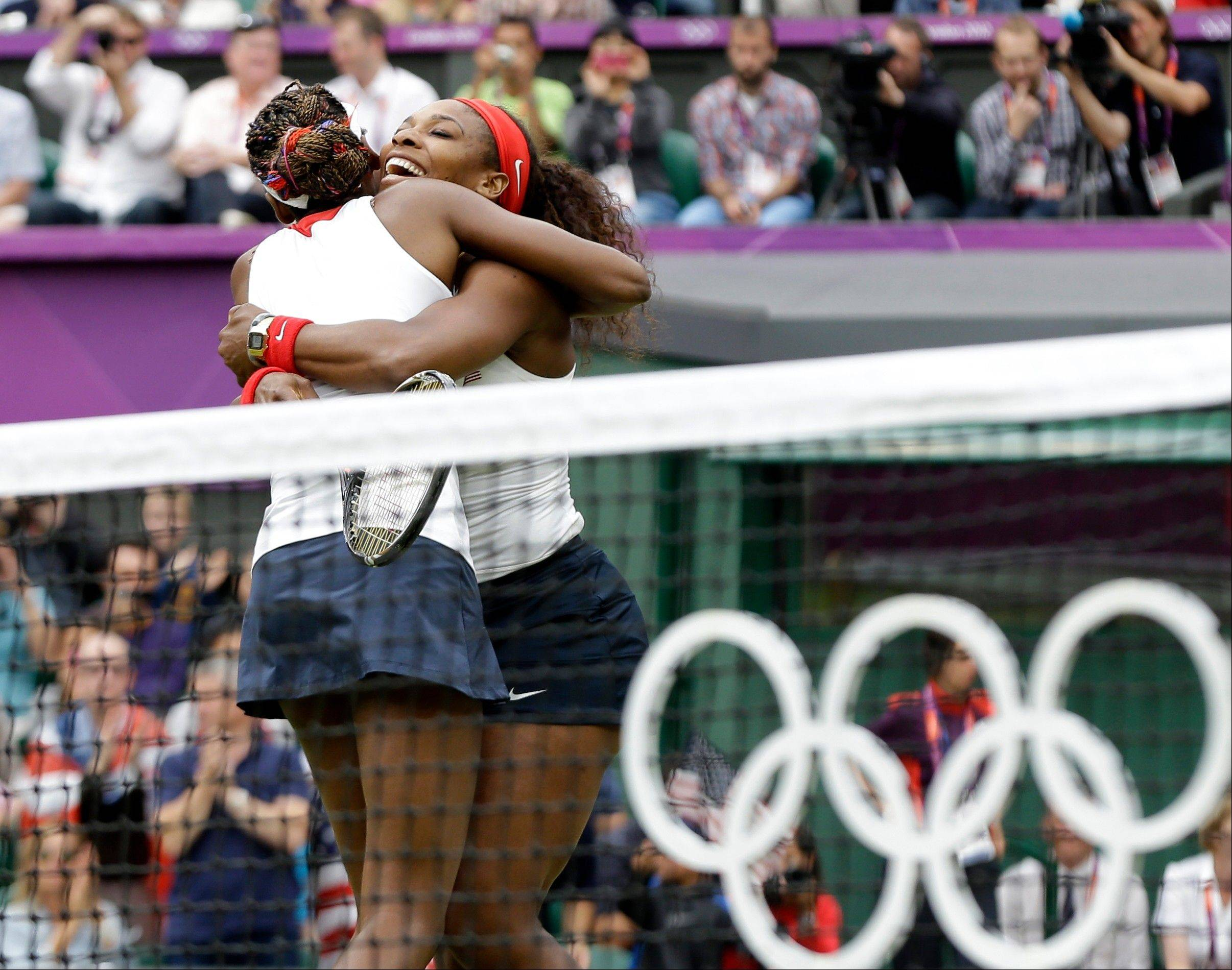 Serena Williams, right, and Venus Williams of the United States celebrate their victory against Andrea Hlavackova and Lucie Hradecka of the Czech Republic in the gold medal women's doubles match at the All England Lawn Tennis Club in Wimbledon, London at the 2012 Summer Olympics, Sunday, Aug. 5, 2012.