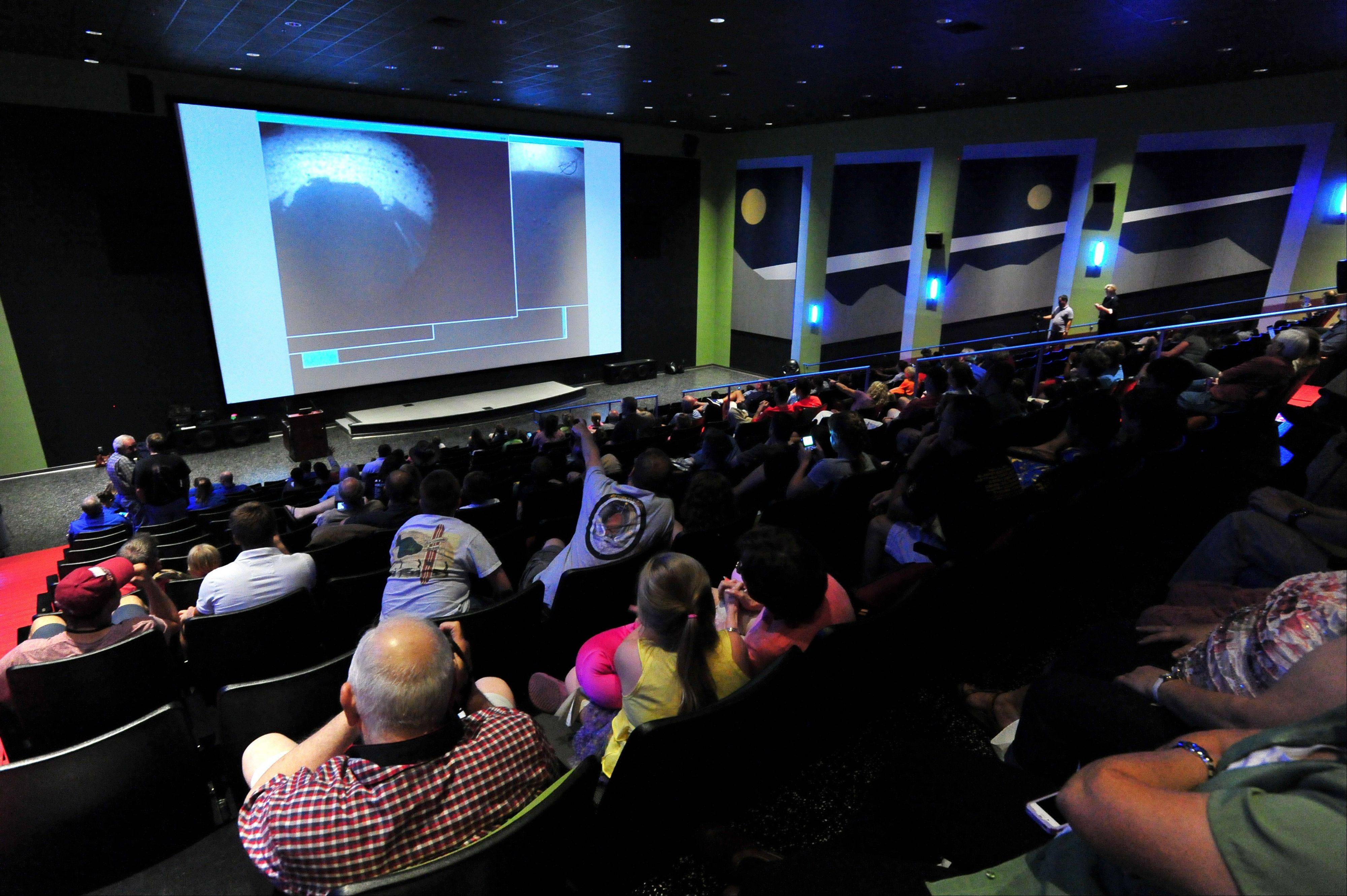 Hundreds watch the images from Mars on the big screen as they watch NASA's Mars Curiosity rover land on Mars during a special viewing event at the U.S. Space and Rocket Center Monday, August 6, 2012 in Huntsville, Ala.