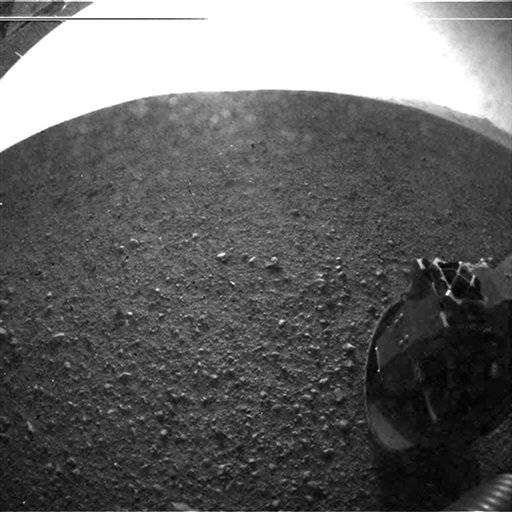 In this photo released by NASA's JPL, this is one of the first images taken by NASA's Curiosity rover, which landed on Mars the evening of Aug. 5 PDT ). It was taken with a
