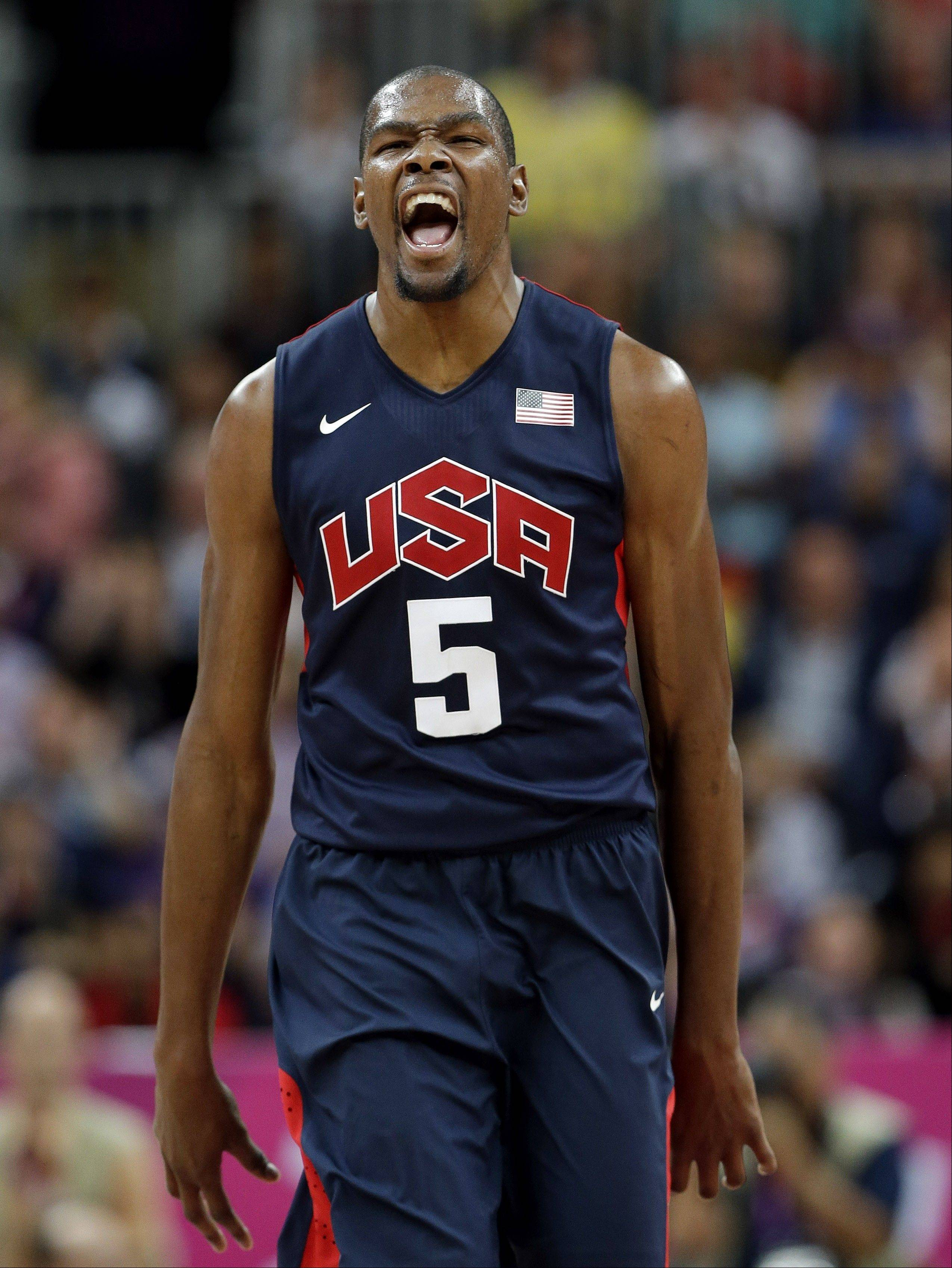 USA's Kevin Durant reacts after hitting a three point basket during a preliminary men's basketball game Monday against Argentina at the 2012 Summer Olympics in London.