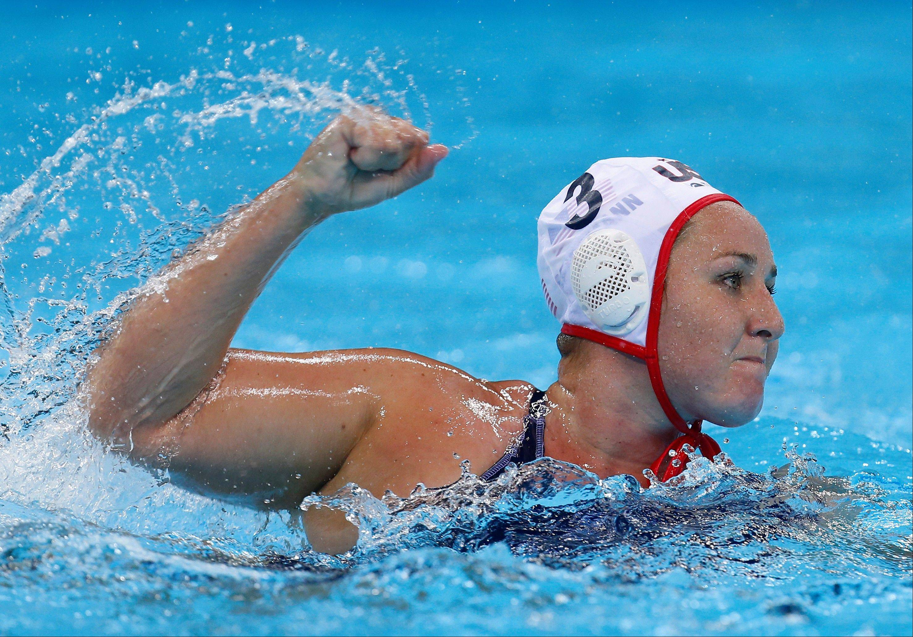 Melissa Seidemann of the United States celebrates after scoring a goal against Australia during their women's semifinal water polo match at the 2012 Summer Olympics, Tuesday, Aug. 7, 2012, in London.