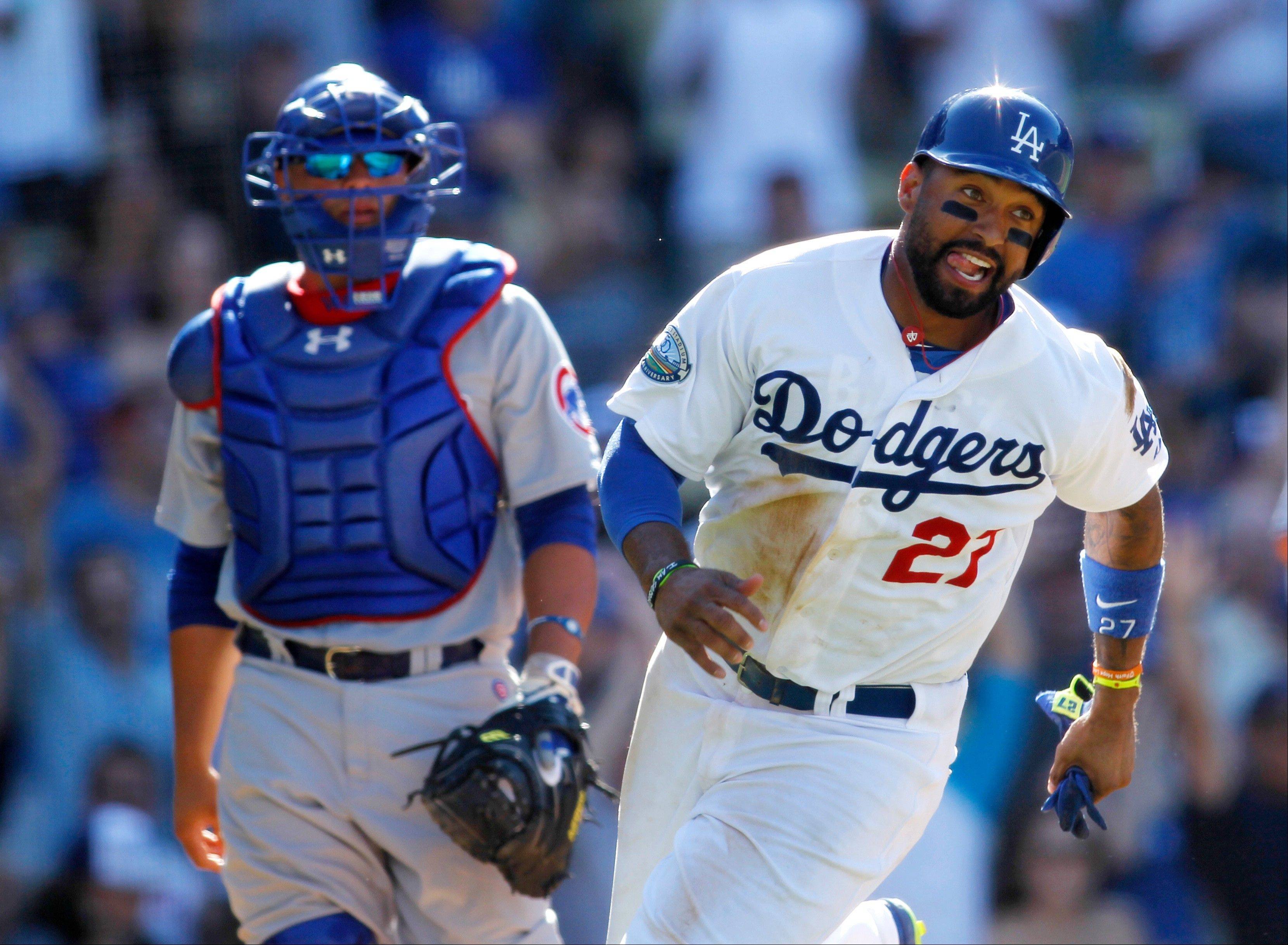 Los Angeles Dodgers outfielder Matt Kemp, right, celebrates as he runs toward Hanley Ramirez after he scored on a walk off single by Ramirez and Cubs catcher Welington Castillo, left, walks off the field Sunday.