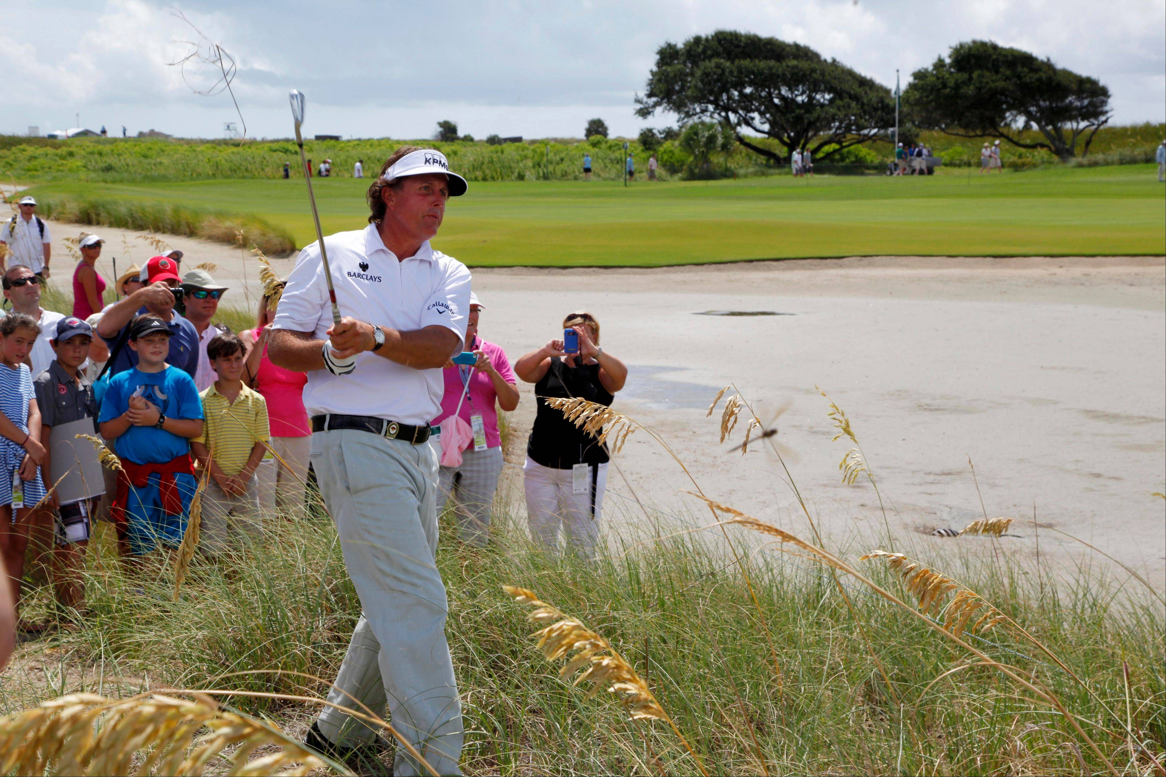 Phil Mickelson watches his shot out of the rough along the seventh hole Tuesday during a practice round for the PGA Championship on the Ocean Course of the Kiawah Island Golf Club in Kiawah Island, S.C.