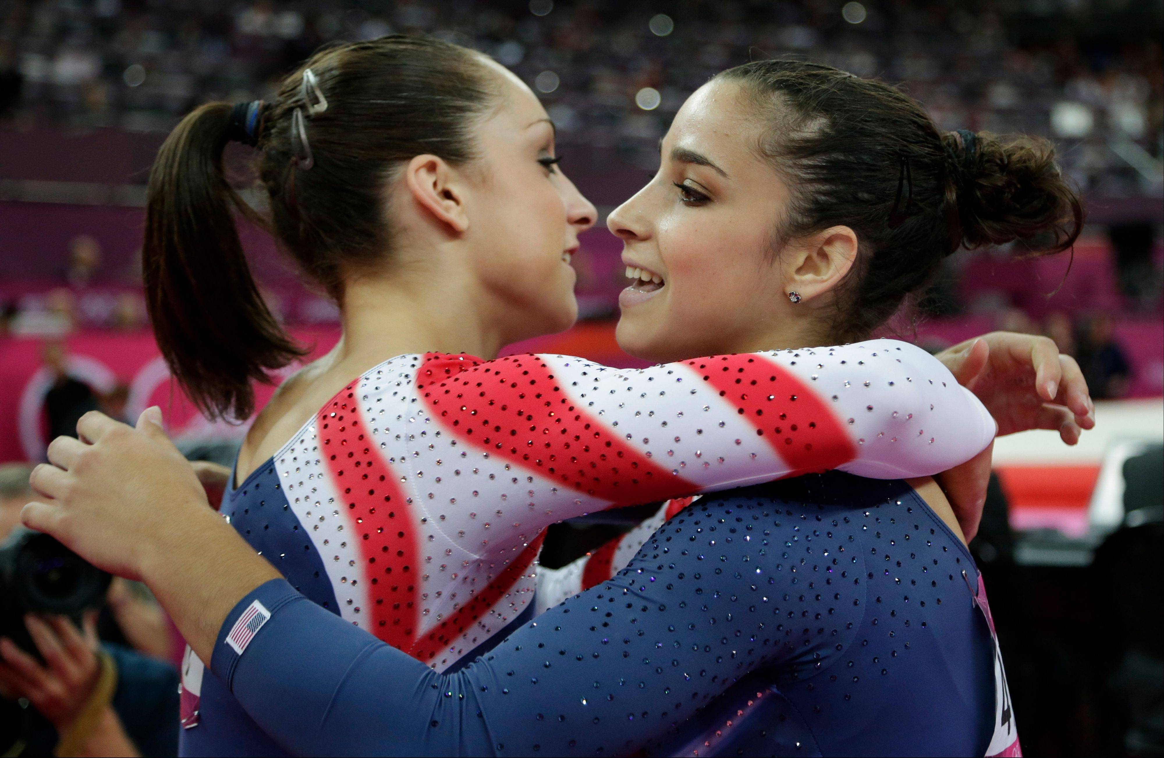 U.S. gymnast Jordyn Wieber, left, hugs teammate Alexandra Raisman after Raisman's performance on the floor Tuesday.