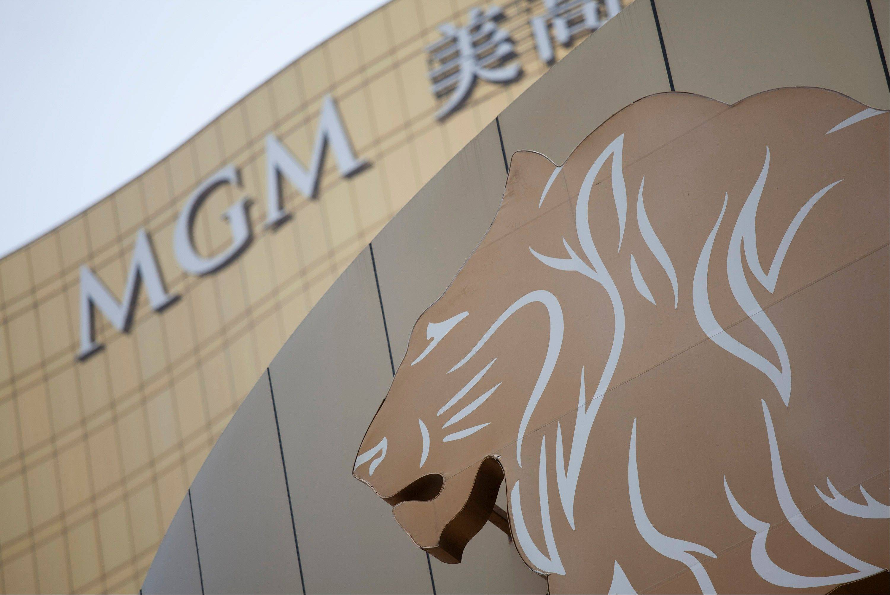 Signage for the MGM Macau casino resort, operated by MGM China Holdings Ltd., is displayed outside the casino in Macau, China, on Tuesday, Aug. 7, 2012. MGM Resorts International, which holds 51 percent of MGM China, is expected to announce second-quarter earnings today.