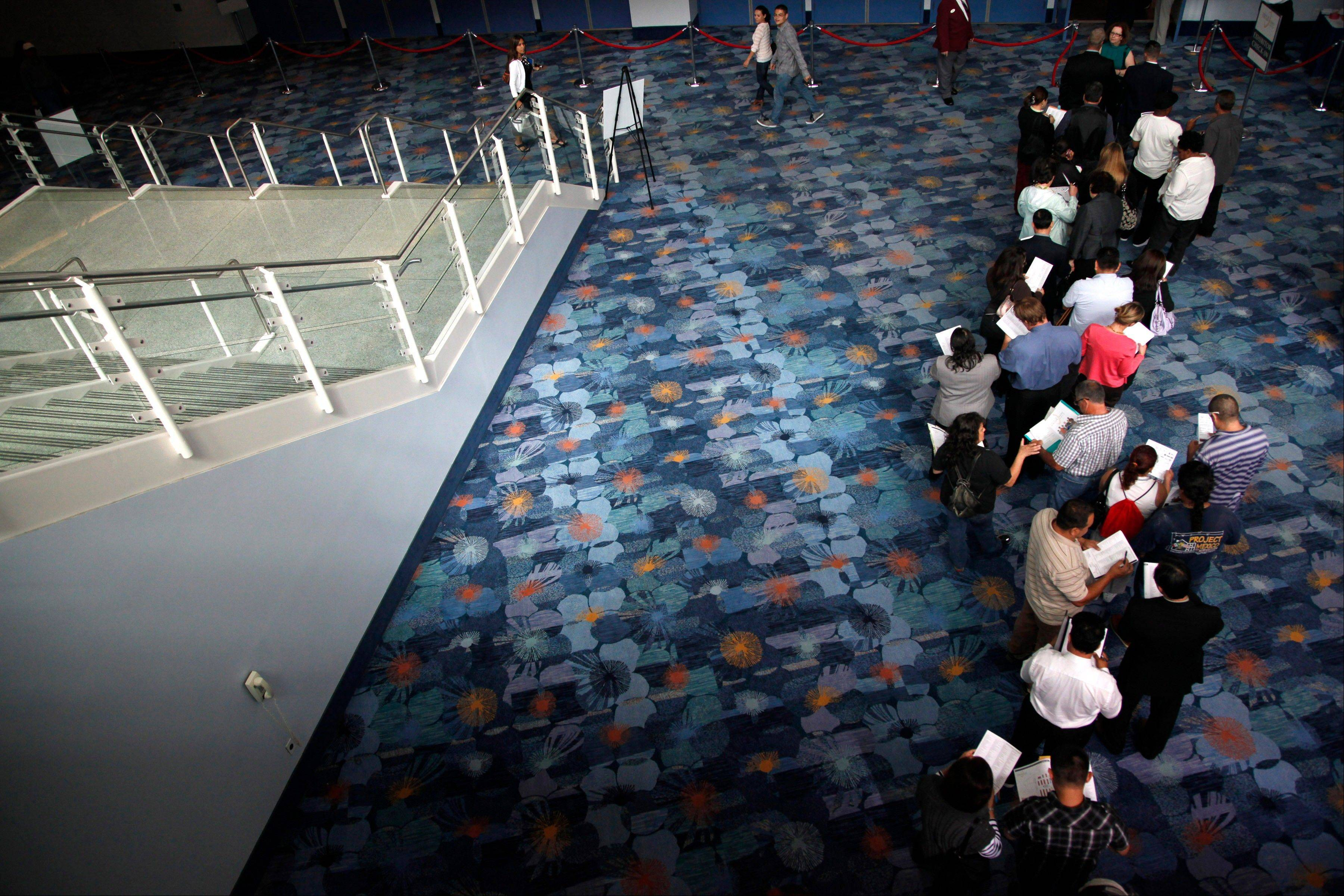 Job seekers wait in line at a job fair expo in Anaheim, Calif. U.S. employers posted the most job openings in four years in June, a positive sign that hiring may pick up. The increase comes after employers added the most jobs in five months in July.