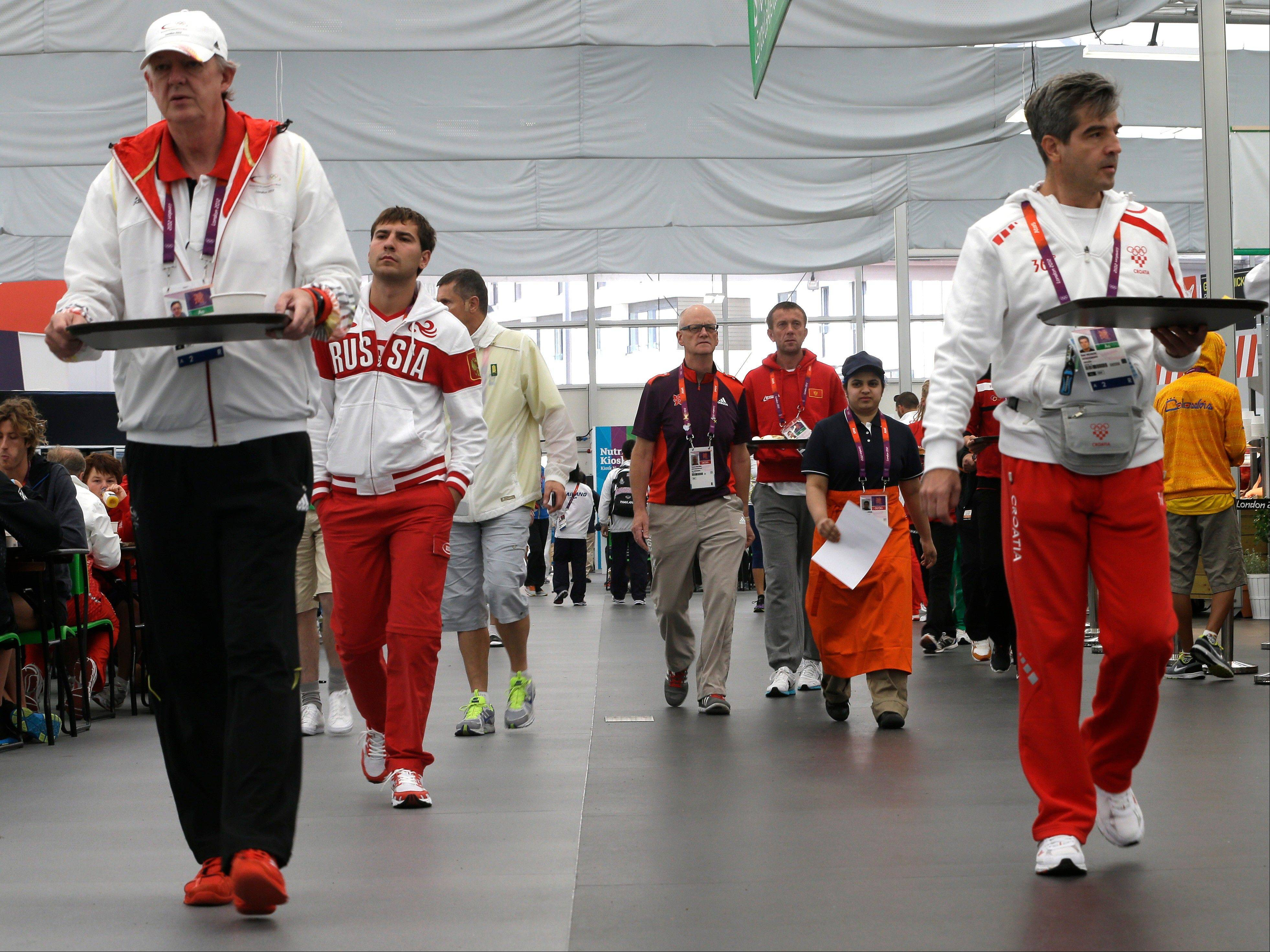 Olympic athletes and training personnel dine at the dining hall inside the Olympic Village in London. The athletes' dining room in the Olympic village is a food court like no other, offering the world's elite athletes healthy, hearty food and fuel, 24 hours a day -- and doing it the Slow Food way.