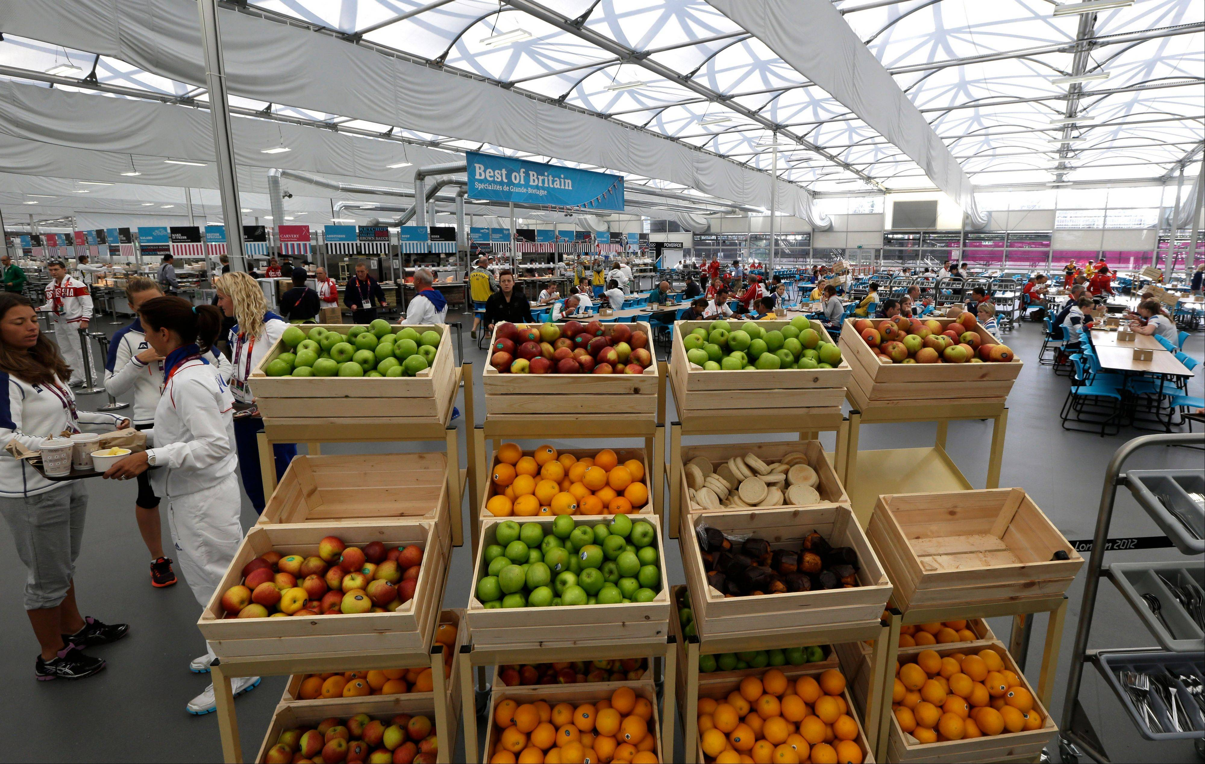 Fresh fruits are on display as Olympic athletes dine at the dining hall inside the Olympic Village in London. The athletes' dining room in the Olympic village is a food court like no other, offering the world's elite athletes healthy, hearty food and fuel, 24 hours a day -- and doing it the Slow Food way.