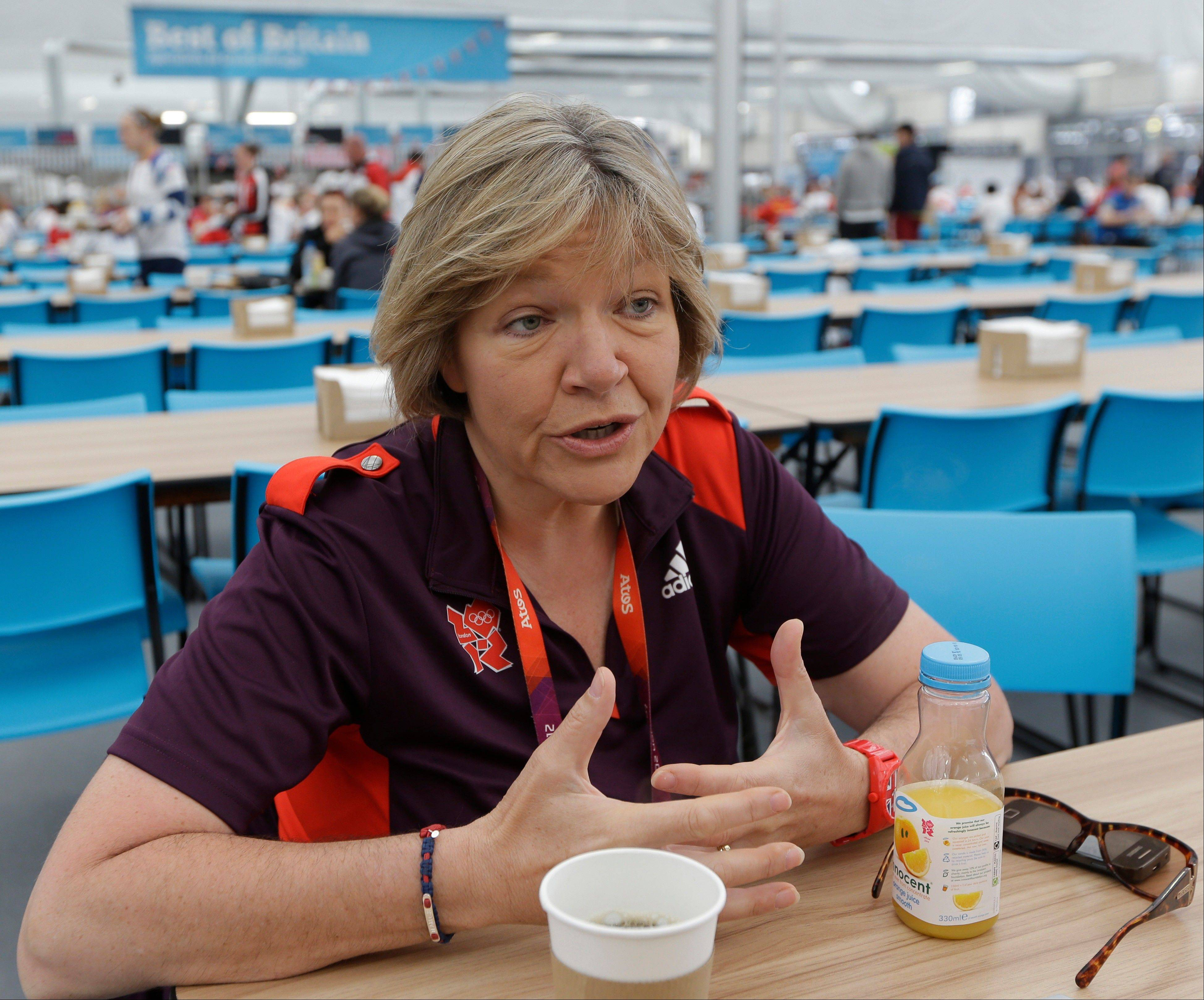 Jan Matthews, Head of Catering, Cleaning and Waste at the Olympic Village talks to the Associated Press at the Athletes' Dining Hall at the Olympic Park Tuesday July 31, 2012 in London. The athletes' dining room in the Olympic village is a food court like no other, offering the world's elite athletes healthy, hearty food and fuel, 24 hours a day -- and doing it the Slow Food way.
