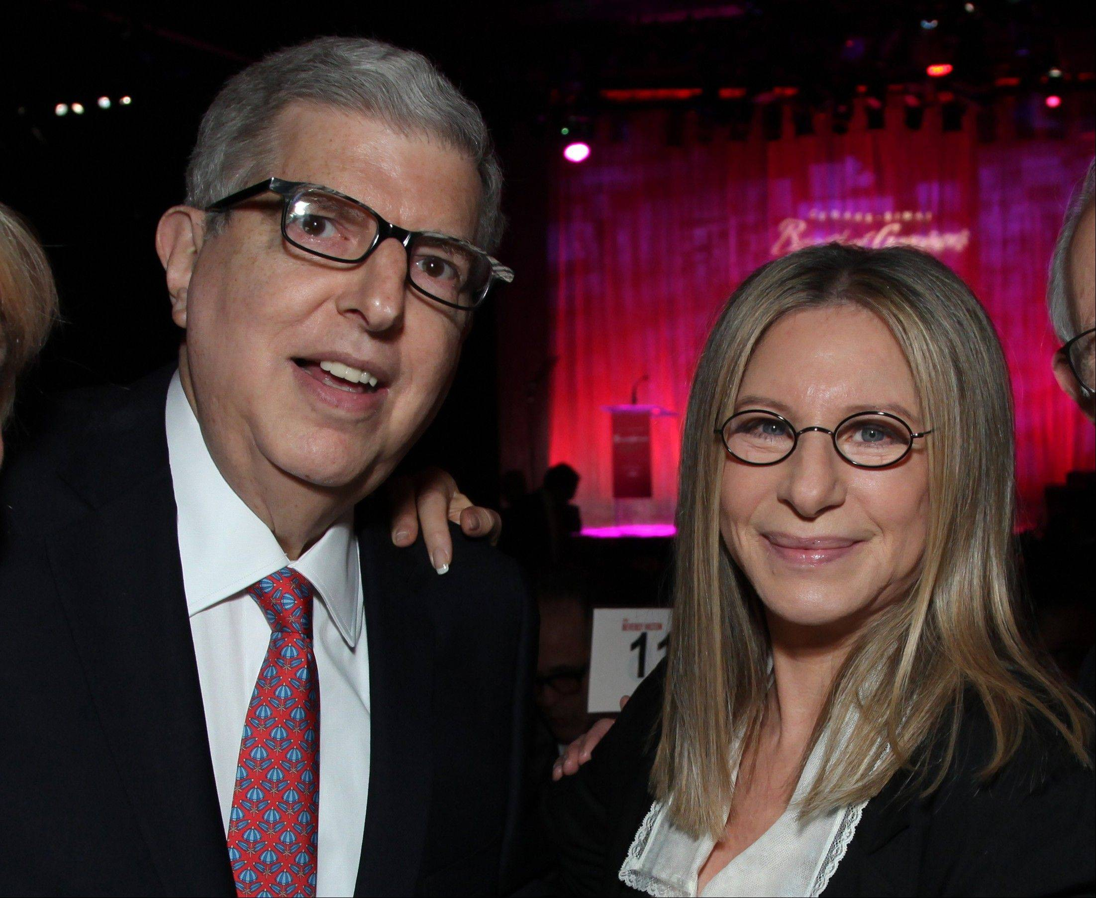 Composer Marvin Hamlisch, here with Barbra Streisand at the Cedars-Sinai Board of Governors Gala in 2011, died Monday, Aug. 6, at age 68.