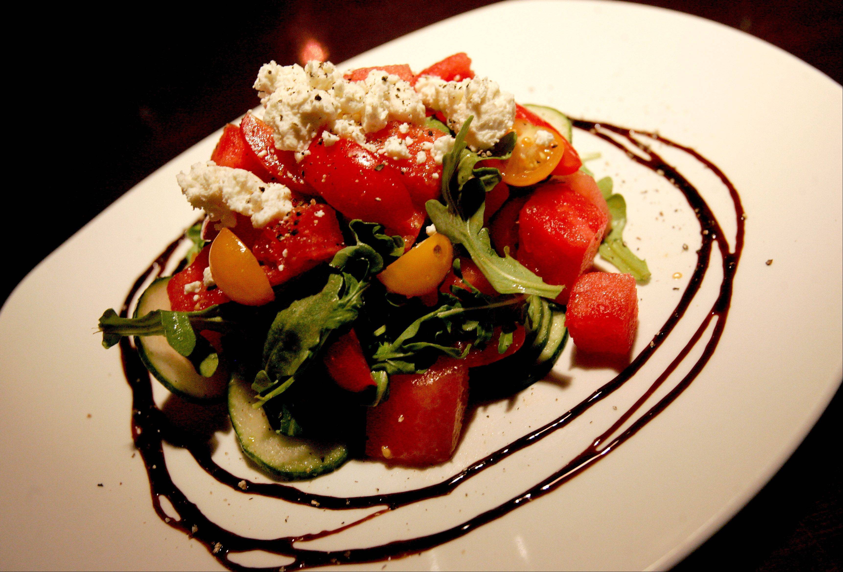 Tomatoes and watermelon come together in a summer salad at Flour + Wine.