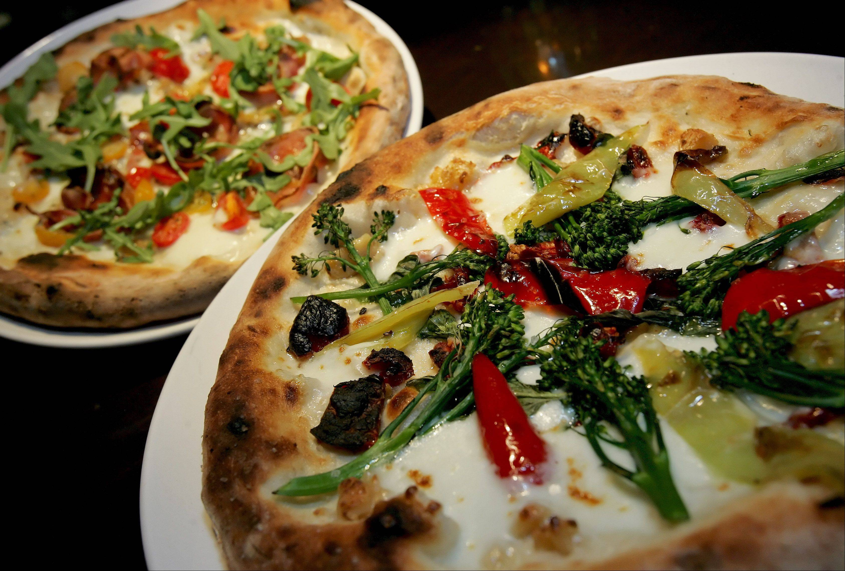 The Parma Classic, left and Rocket Man Pizza are two of the most popular at Flour + Wine in Glen Ellyn.